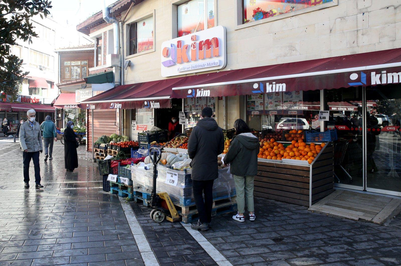 Citizens shop at a local market the Beyoğlu district, Istanbul, Turkey, Jan. 24, 2021. (AA Photo)