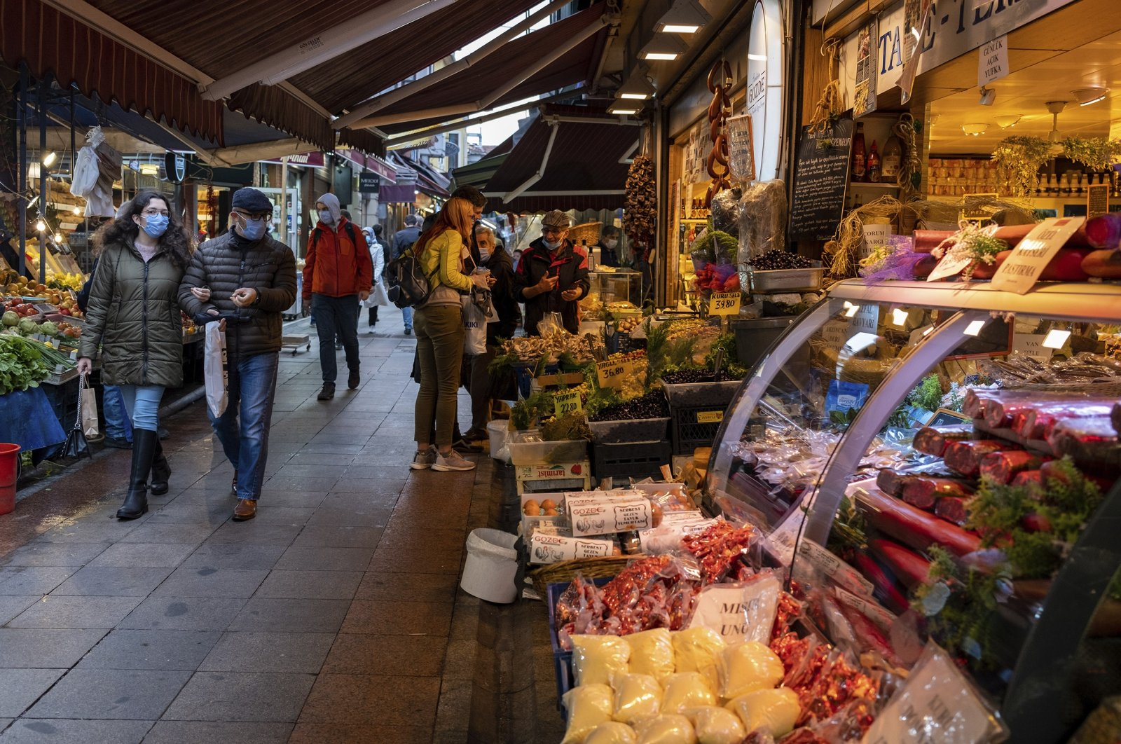 People shop in a local market in the Kadıköy district, Istanbul, Turkey, Nov. 9, 2020. (Photo by Getty Images)