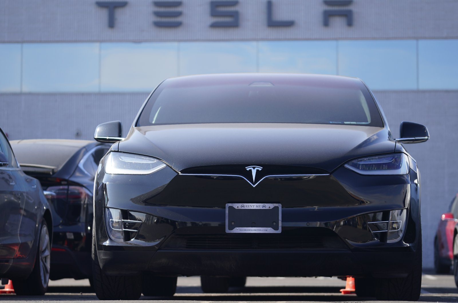 An unsold 2021 Model X sports-utility vehicle sits at a Tesla dealership, in Littleton, Colorado, U.S., Jan. 24, 2021. (AP Photo)