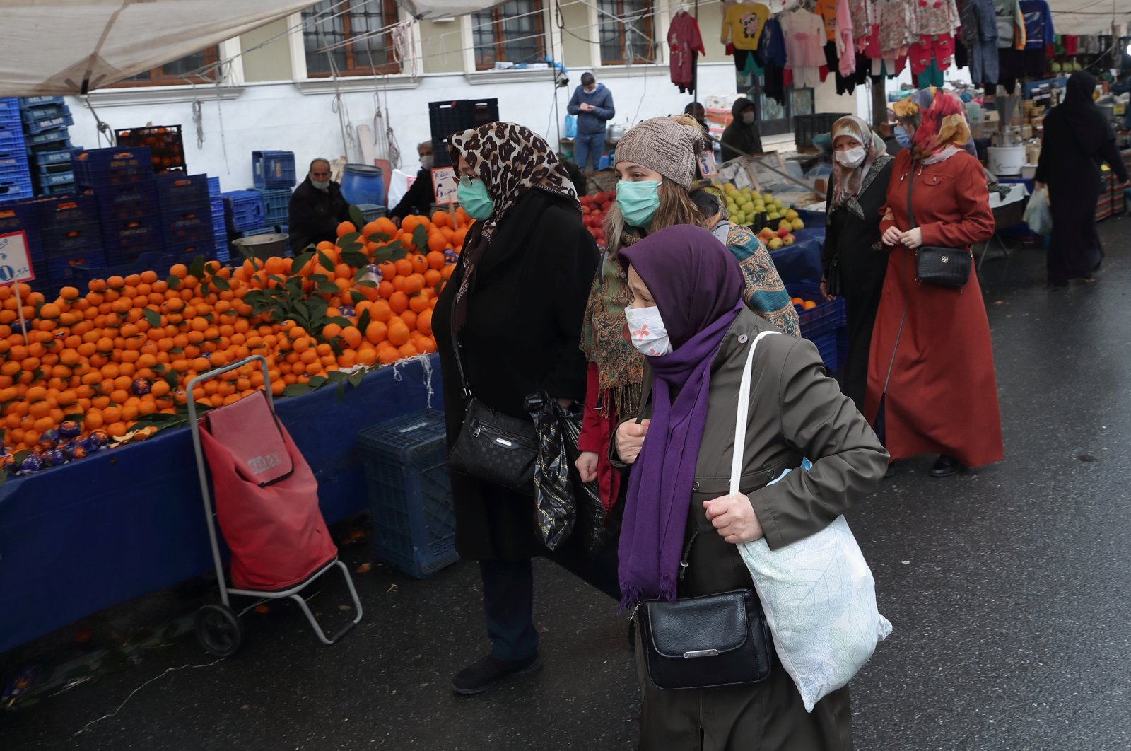 People shop at a local market in the Fatih district of Istanbul, Turkey, Jan. 13, 2021. (Reuters Photo)