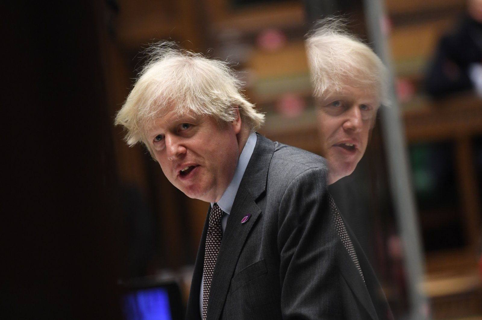 Britain's Prime Minister Boris Johnson takes part in the weekly Prime Minister's Questions, in a hybrid, socially distanced session at the House of Commons in London, U.K, Jan. 27, 2021. (Photo by Jessica Taylor / U.K. Parliament via AFP)