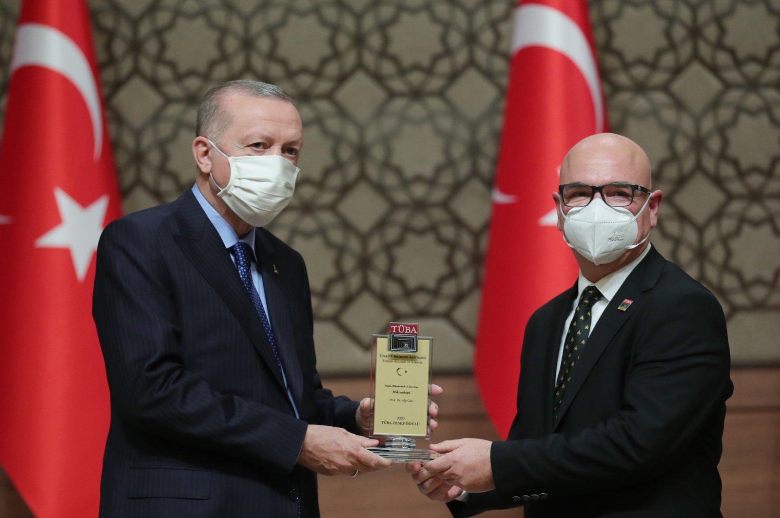 President Recep Tayyip Erdoğan (L) gives an award to professor Alp Can at the science awards ceremony, in the capital Ankara, Turkey, Jan. 28, 2021. (AA Photo)