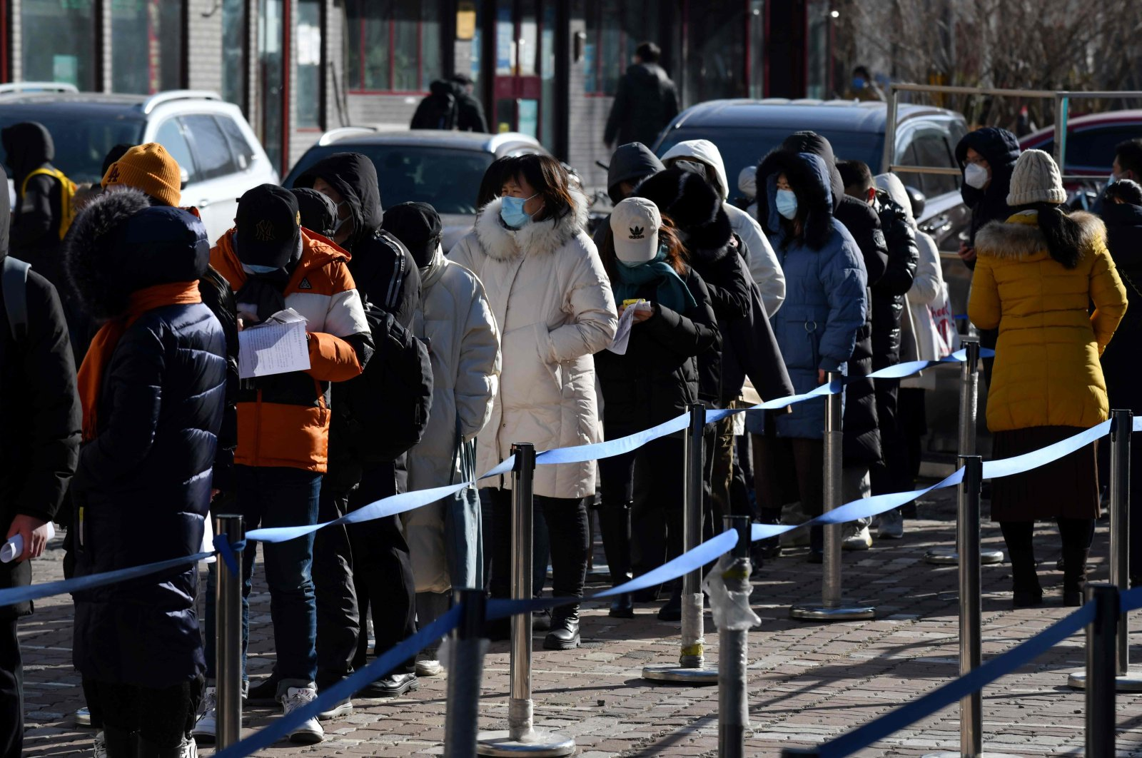 People line up to be tested for COVID-19 outside a hospital in Beijing on Jan. 28, 2021. (AFP Photo)