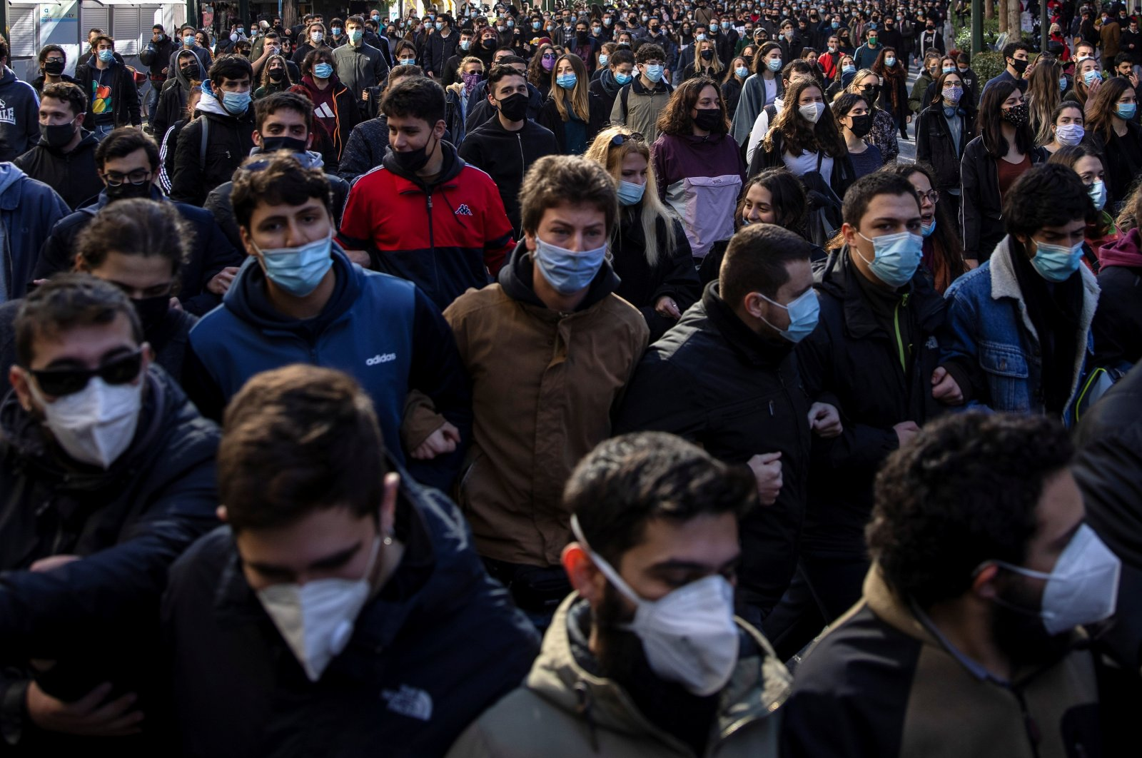 Greek university students, wearing protective face masks, shout slogans during a demonstration against government plans to set up university police units, amid the coronavirus pandemic, in Athens, Greece, Jan. 21, 2021. (Reuters Photo)
