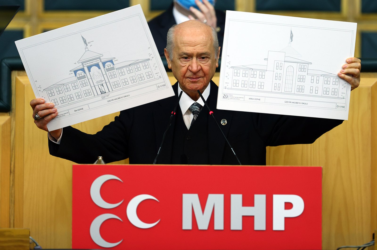 Nationalist Movement Party (MHP) Chairperson Devlet Bahçeli during his party's parliamentary group meeting in Ankara shows the plans of the school to be built in Azerbaijan's key city Shusha, Jan. 26, 2021. (AA Photo)