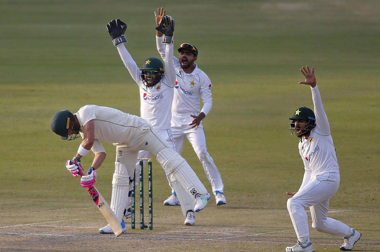 Pakistan's Mohammad Rizwan (C), Babar Azam (2nd R) and Imran Butt (R) appeal for an LBW out of South Africa's Faf du Plessis (L), Day 3 of the first Test at the National Stadium, Karachi, Pakistan, Jan. 28, 2021. (AP Photo)