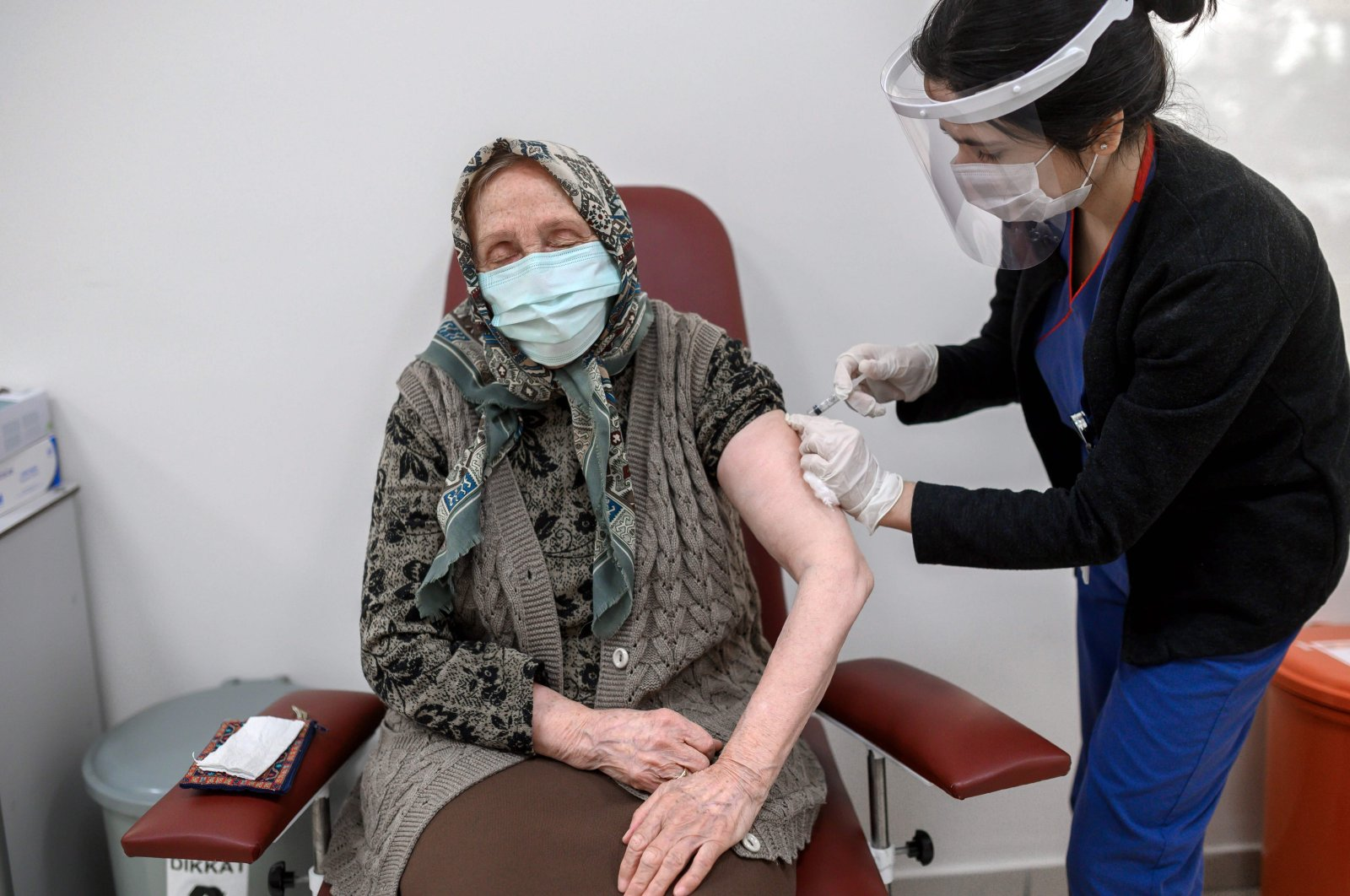 A woman receives an injection of the CoronaVac COVID-19 vaccine at a hospital in Istanbul, Turkey, Jan. 28, 2021 (AFP Photo)
