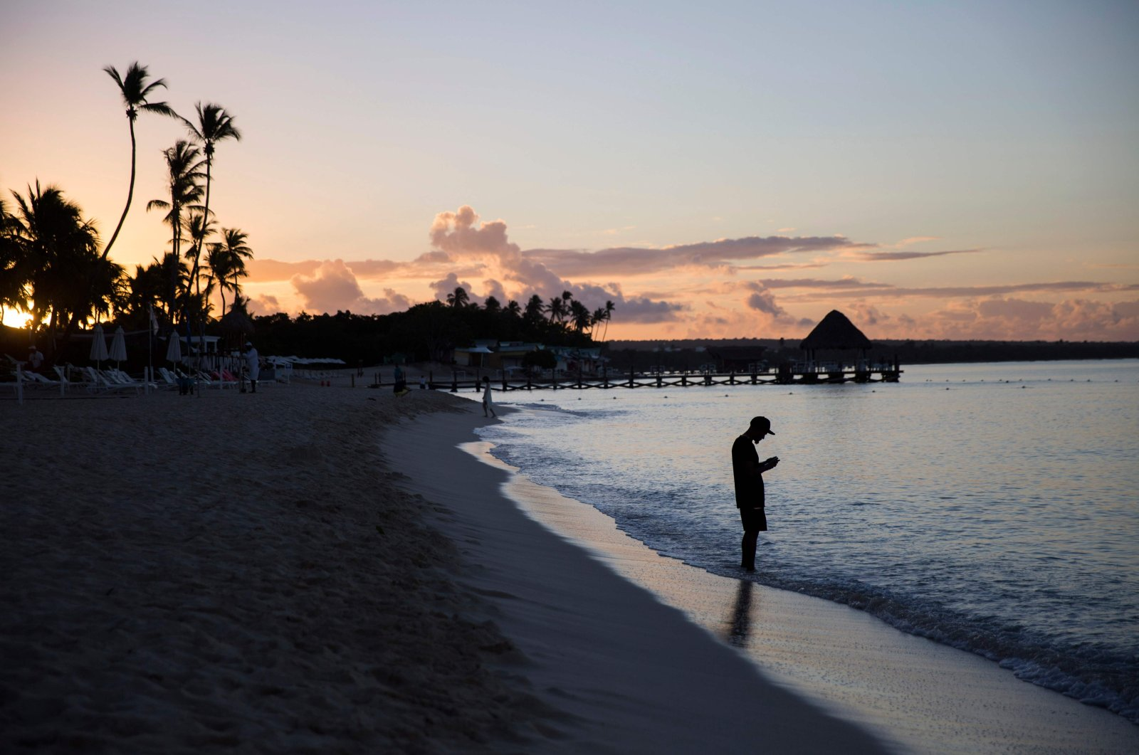 A tourist enjoys the beach of an all-inclusive hotel after its reopening in Bayahibe, La Altagracia province, eastern Dominican Republic, Jan. 23, 2021. (AFP Photo)