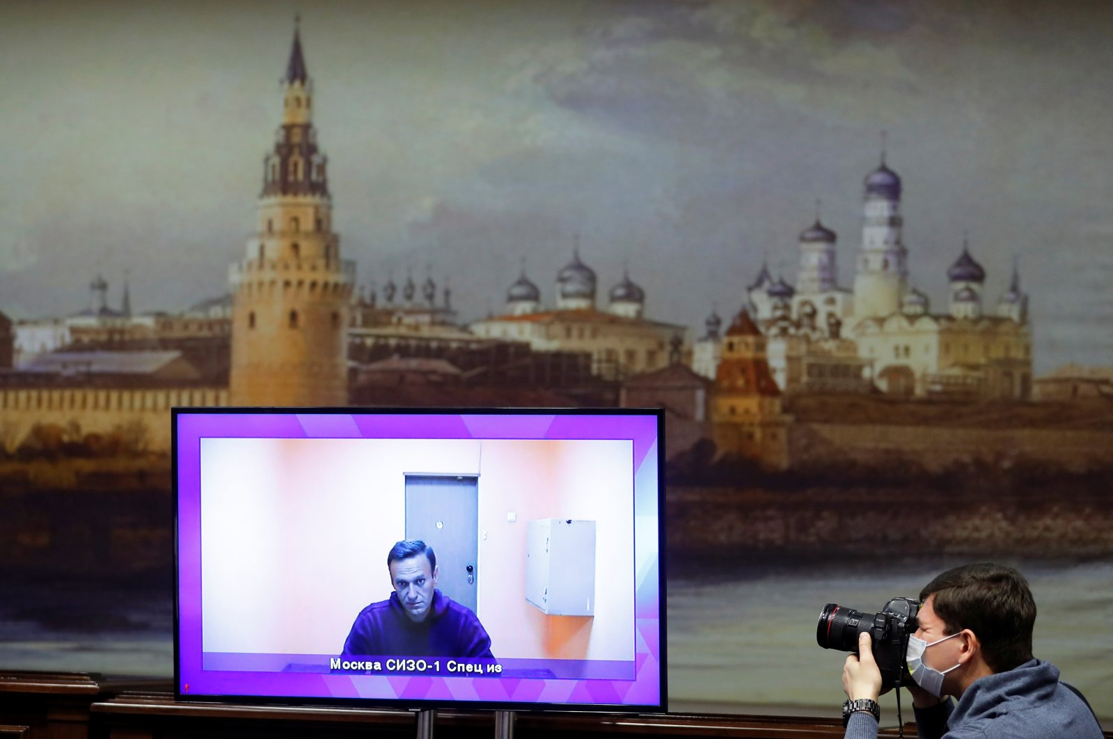A photographer takes pictures of a screen showing Russian opposition leader Alexei Navalny via a video link during a court hearing to consider an appeal on his arrest outside Moscow, Russia, Jan. 28, 2021. (Reuters Photo)