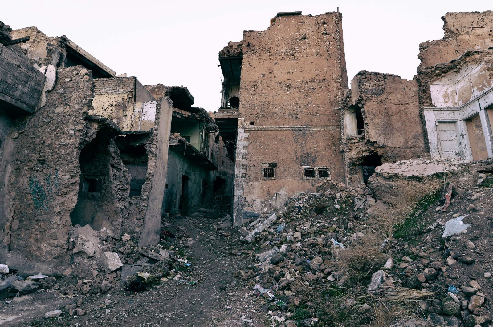 A picture shows destroyed buildings in Iraq's northern city of Mosul, which was captured by the Daesh terror group in 2014 and was liberated by the Iraqi Army in mid-2017, Jan. 18, 2021. (AFP Photo)