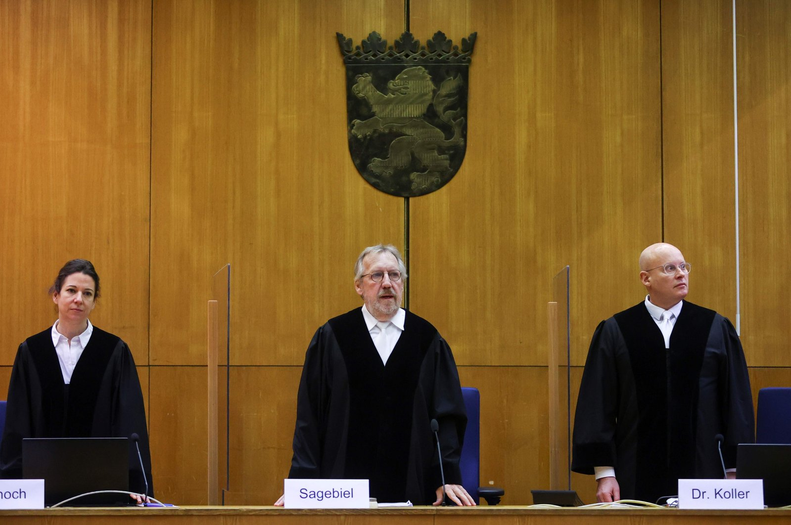Presiding Judge Thomas Sagebiel (C) stands between judges Miriam Adlhoch (L) and Christoph Koller (R) in the courtroom prior to the verdict in the case of the murder of Walter Luebcke, at the Higher Regional Court in Frankfurt am Main, western Germany, Jan. 28, 2021. (AFP Photo)