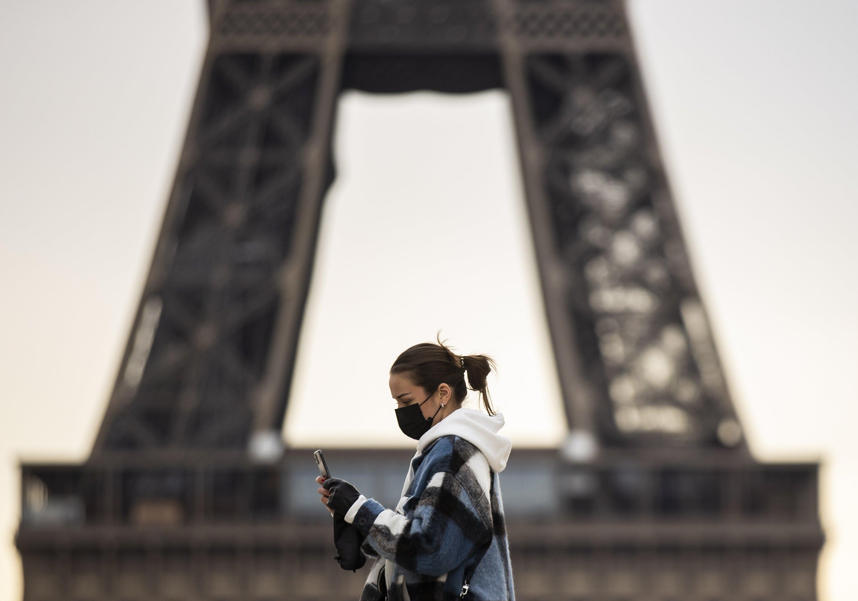 A pedestrian wearing a protective mask walks near the Eiffel Tower in Paris, France, Jan. 26, 2021. (EPA Photo)