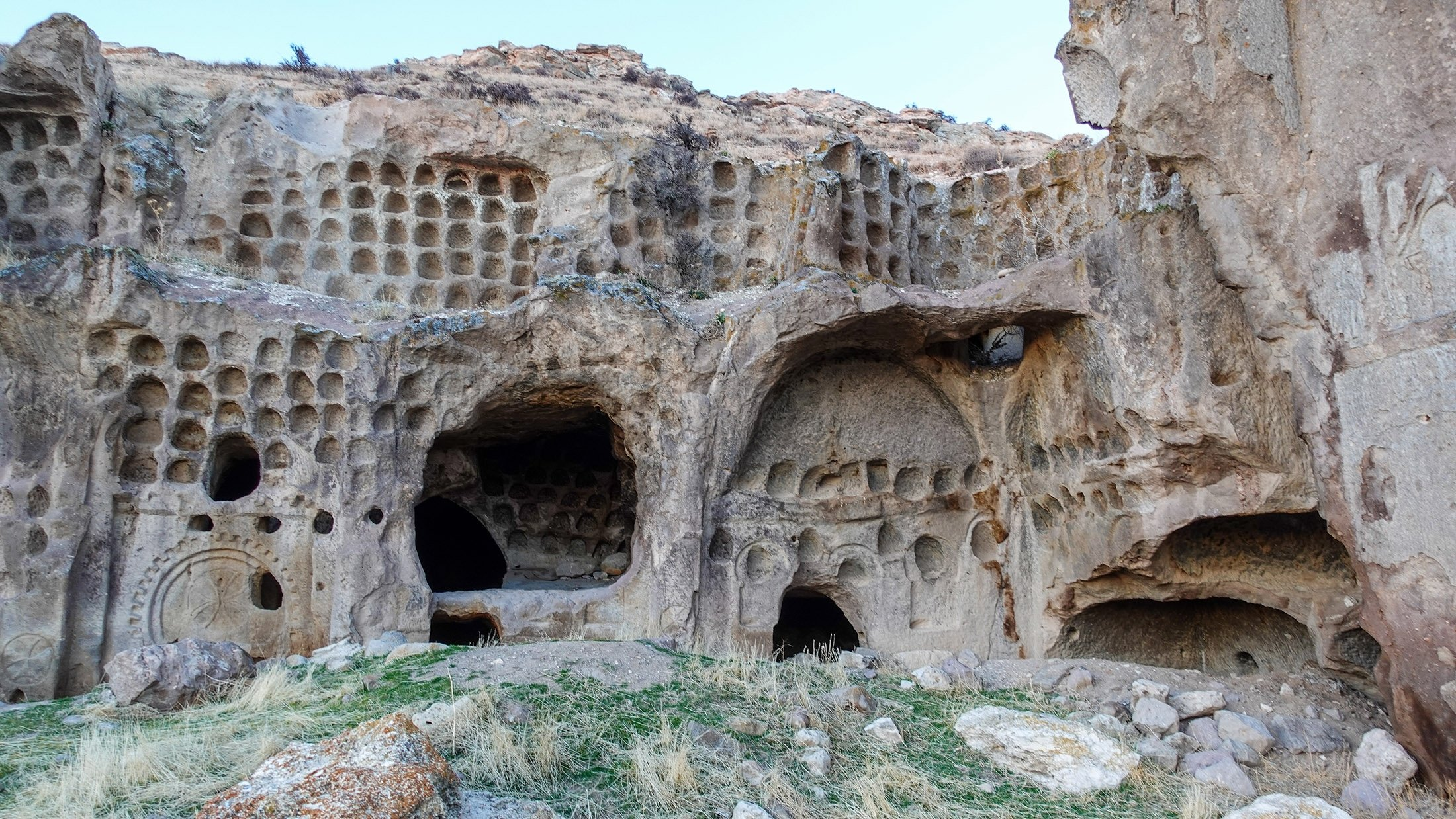 The facade of one of the residential cave units, covered in pigeon lofts which were used to collect pigeon dung for fertilizer. (Photo by Argun Konuk)