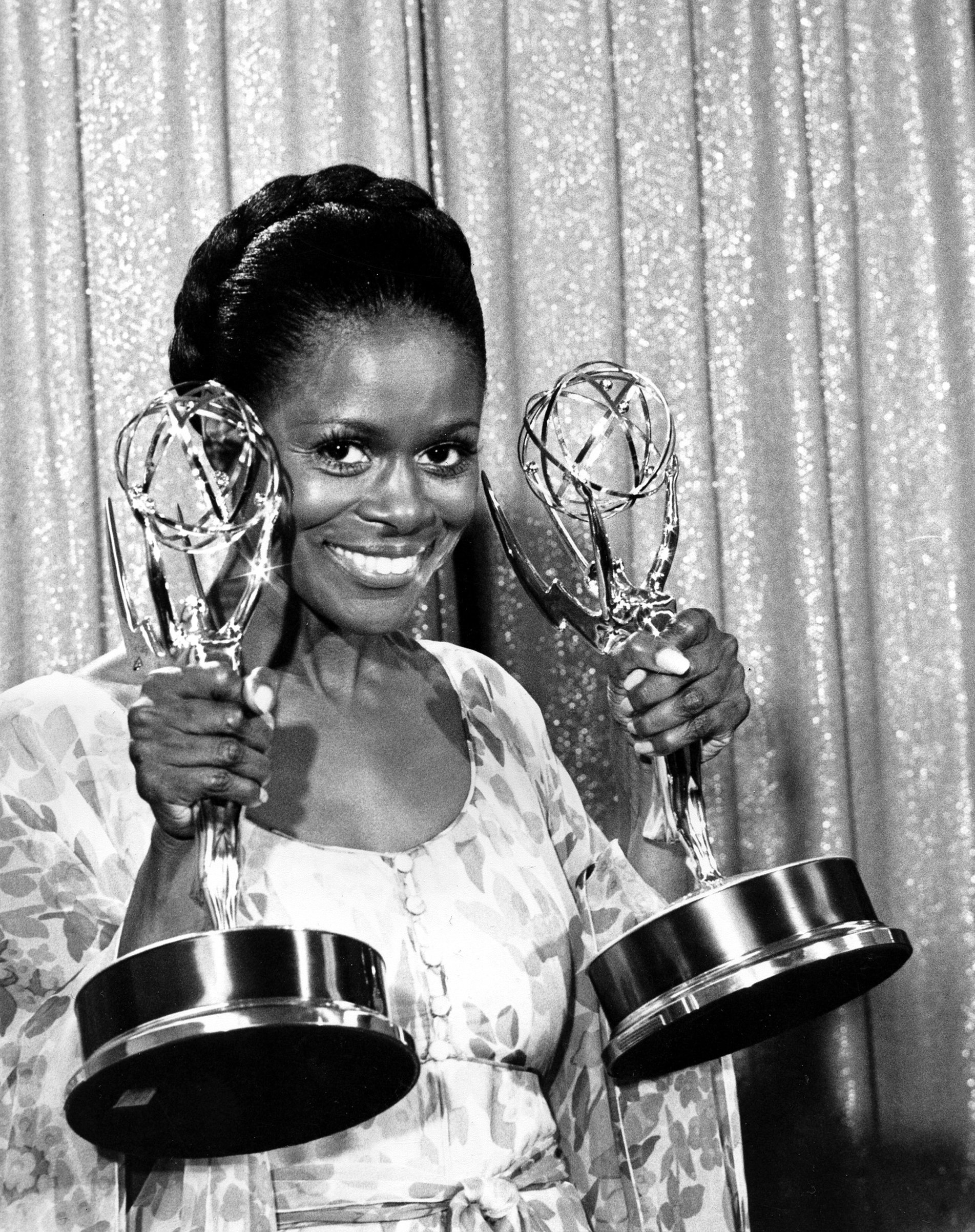 Cicely Tyson poses with her Emmy statuettes at the annual Emmy Awards presentation in Los Angeles, California, U.S., May 28, 1974. (AP Photo)