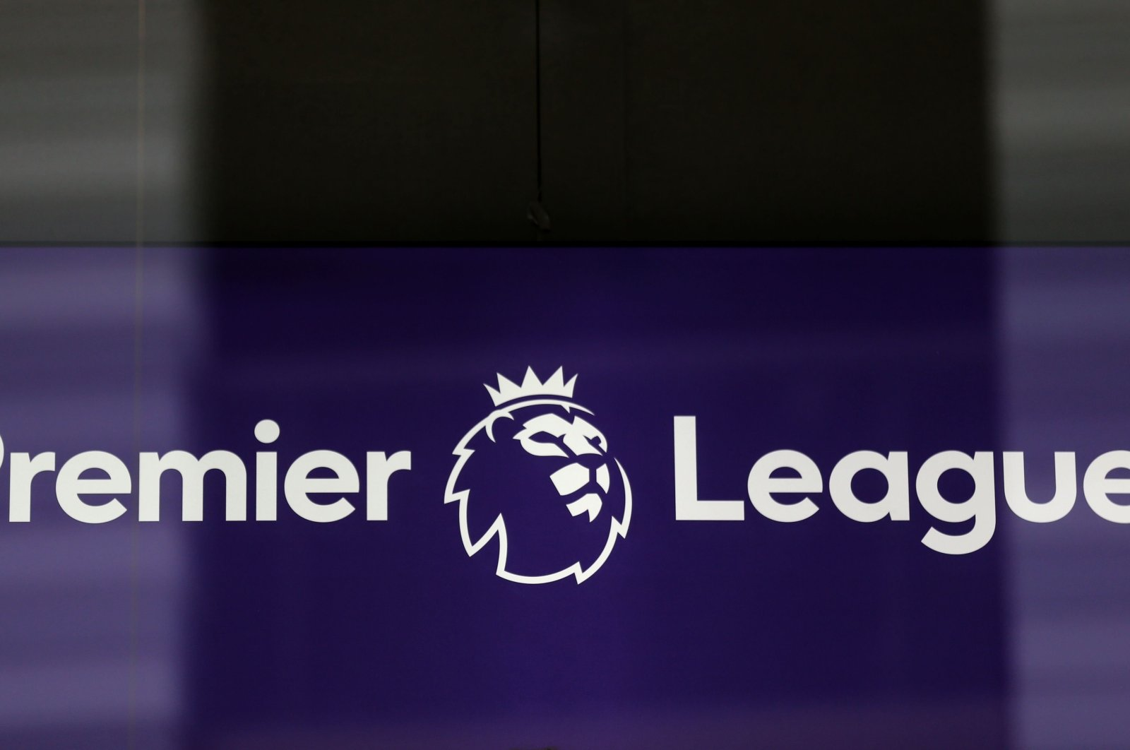 The Premier League logo is pictured through a glass window at the league's headquarters in London, Britain, March 13, 2020. (AFP Photo)
