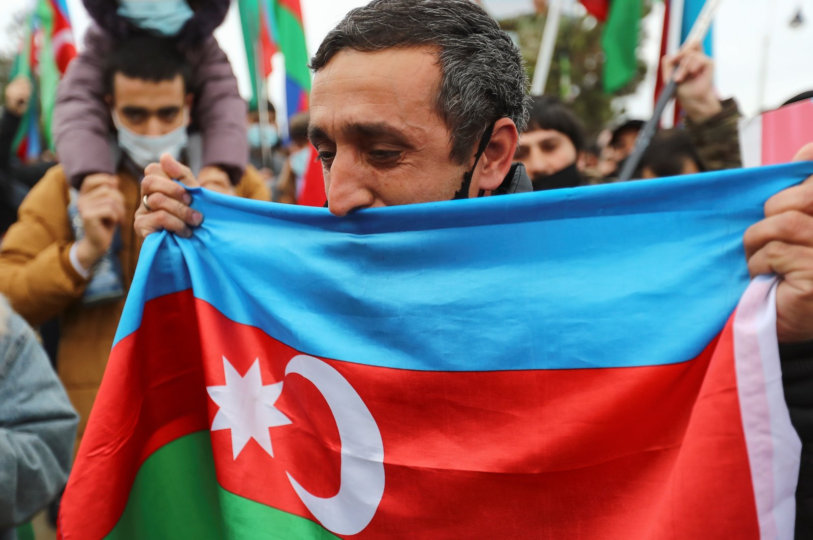 People take part in street celebrations after Lachin District reportedly came under the control of Azerbaijan's troops following a military conflict over Nagorno-Karabakh against ethnic Armenian forces and a further signing of a ceasefire deal, in Baku, Azerbaijan, Dec.1, 2020. (REUTERS)