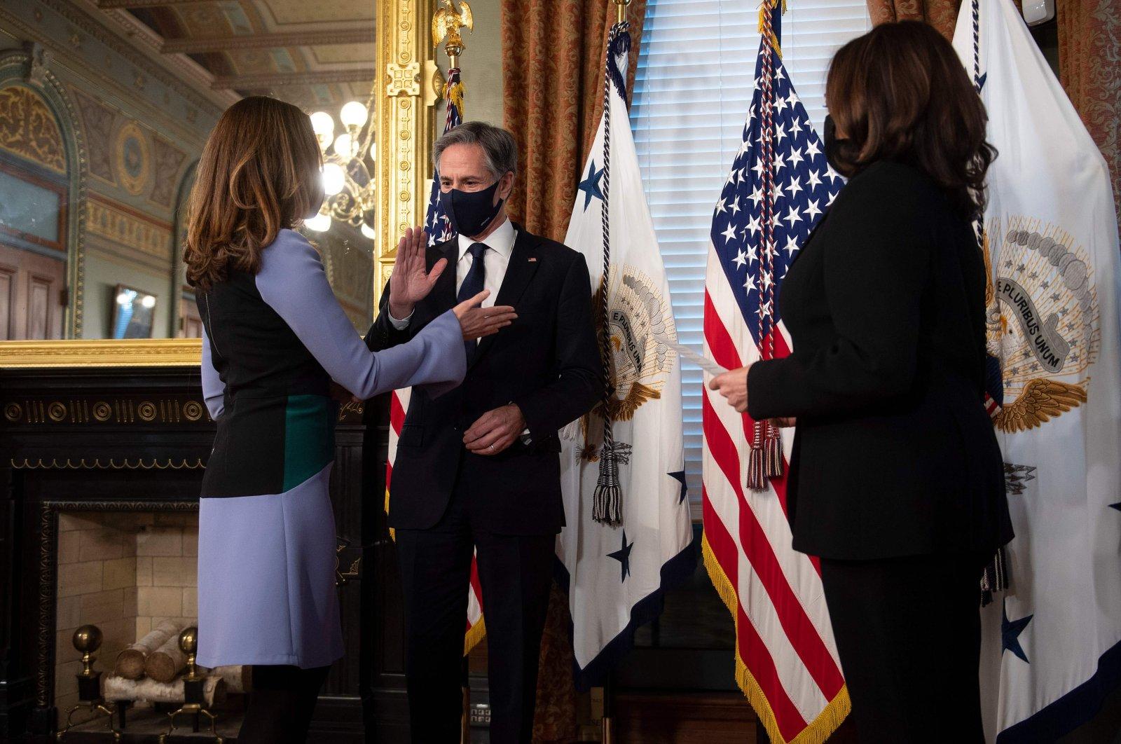 U.S. Secretary of State Antony Blinken and his wife Evan Ryan (L) take part in a ceremonial swearing-in with U.S. Vice President Kamala Harris (R), Washington, D.C., the U.S., Jan. 27, 2021. (AFP Photo)