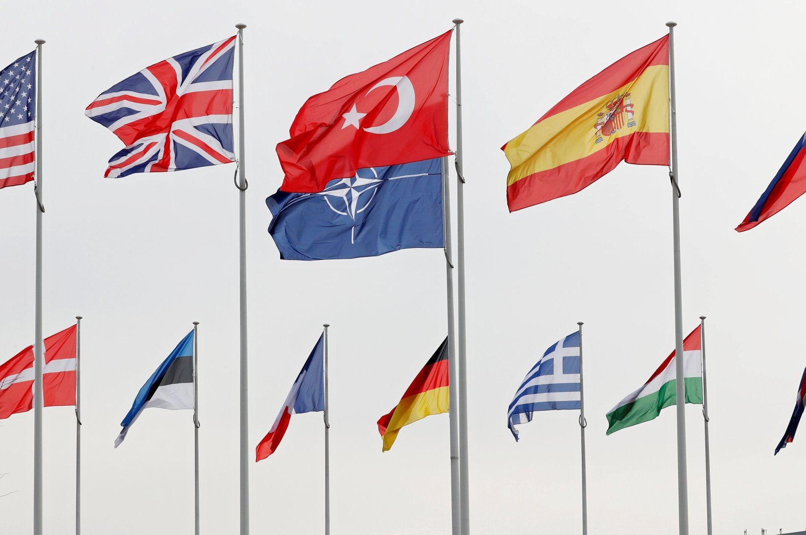 NATO member flags flutter at the alliance's headquarters in Brussels, Belgium, Feb. 28, 2020. (Reuters Photo)