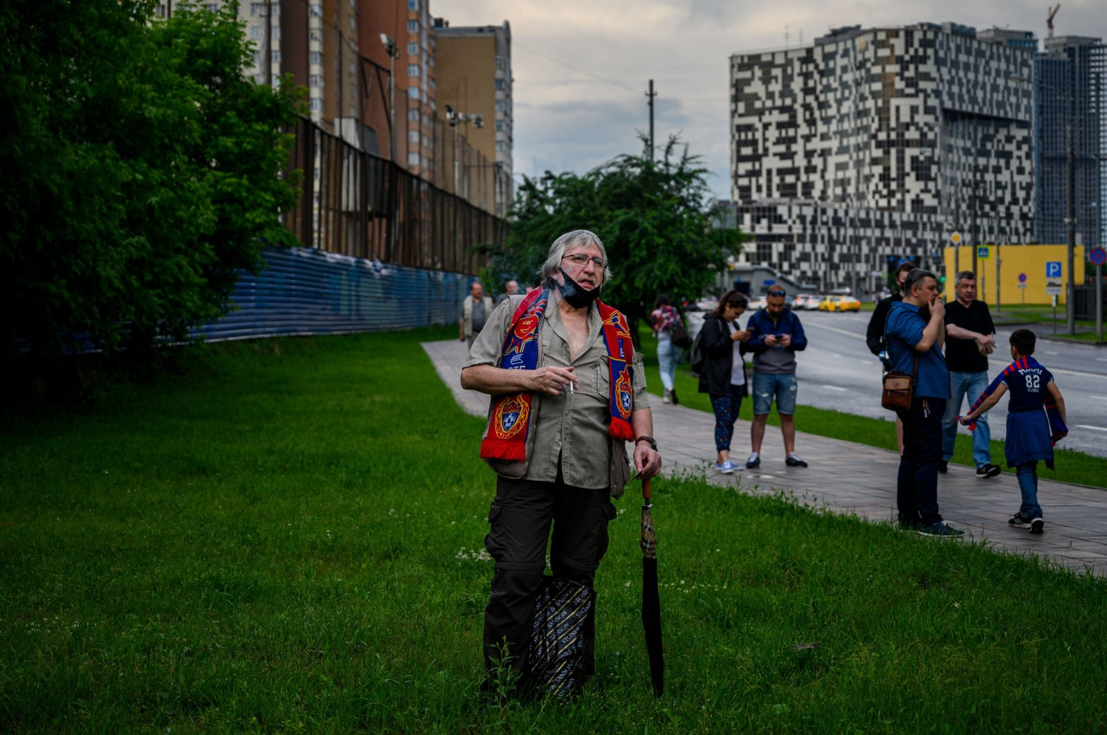 A CSKA Moscow fan smokes a cigarette before entering the VEB Arena to watch the Russian Premier League football match between CSKA Moscow and Zenit St. Petersburg in Moscow, Russia, June 20, 2020. (AFP Photo)