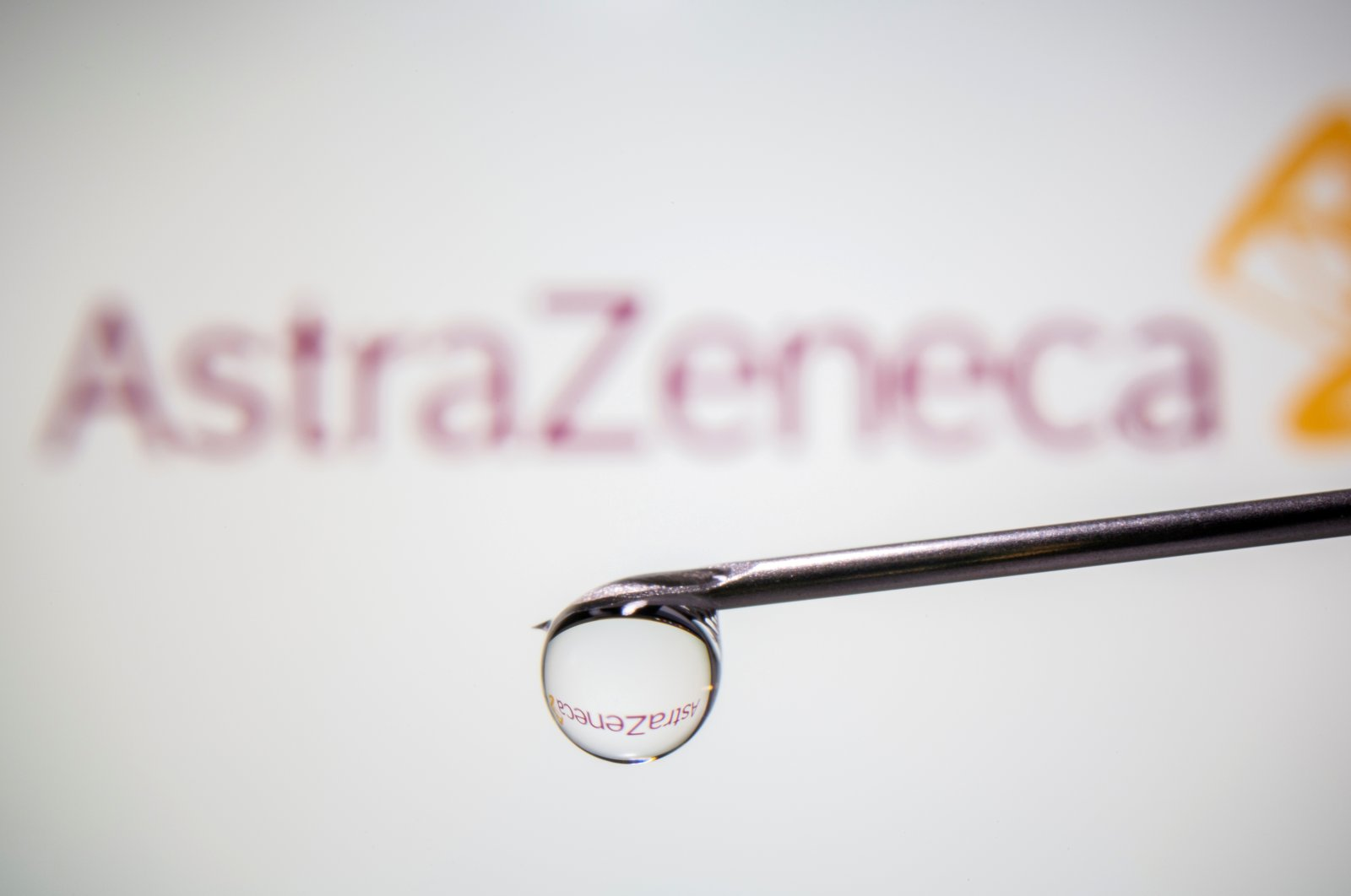 AstraZeneca's logo is reflected in a drop on a syringe needle in this illustration taken Nov. 9, 2020. (Reuters Photo)