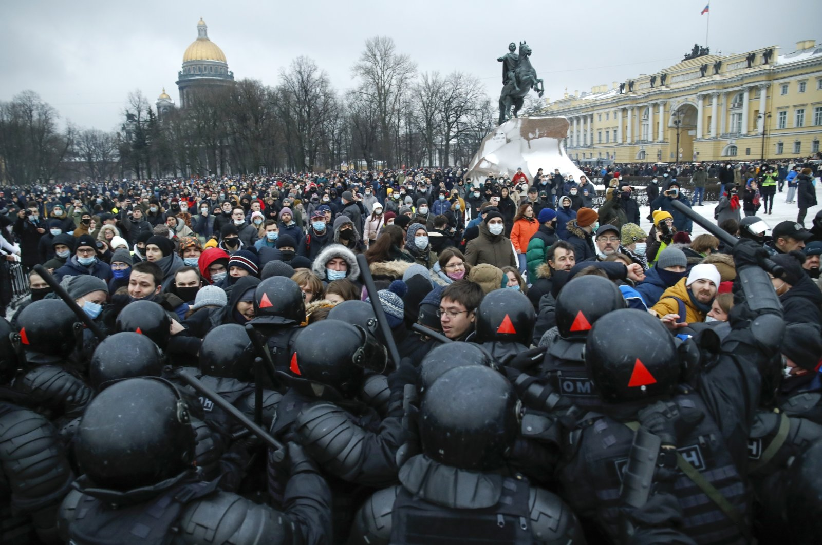 People clash with police during a protest against the jailing of opposition leader Alexei Navalny in St. Petersburg, Russia, Jan. 23, 2021. (AP Photo)