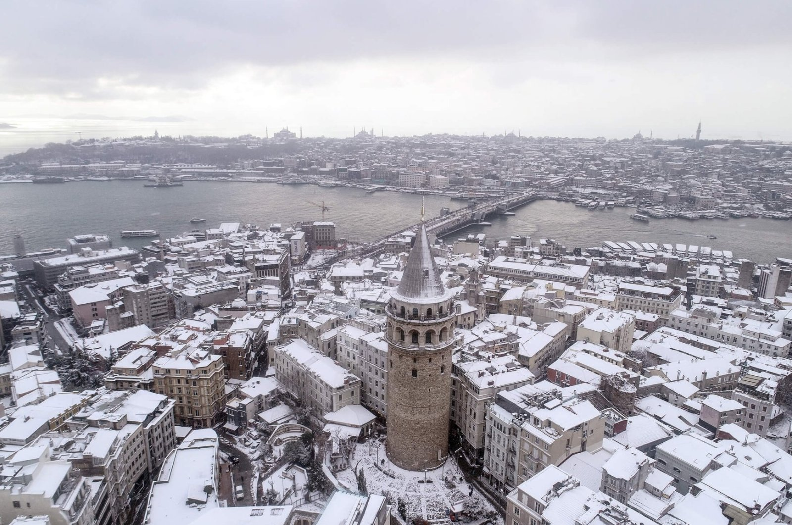 A view of Galata Tower and its surroundings covered in snow, in Istanbul, Turkey, Jan. 18, 2021. (AA PHOTO)