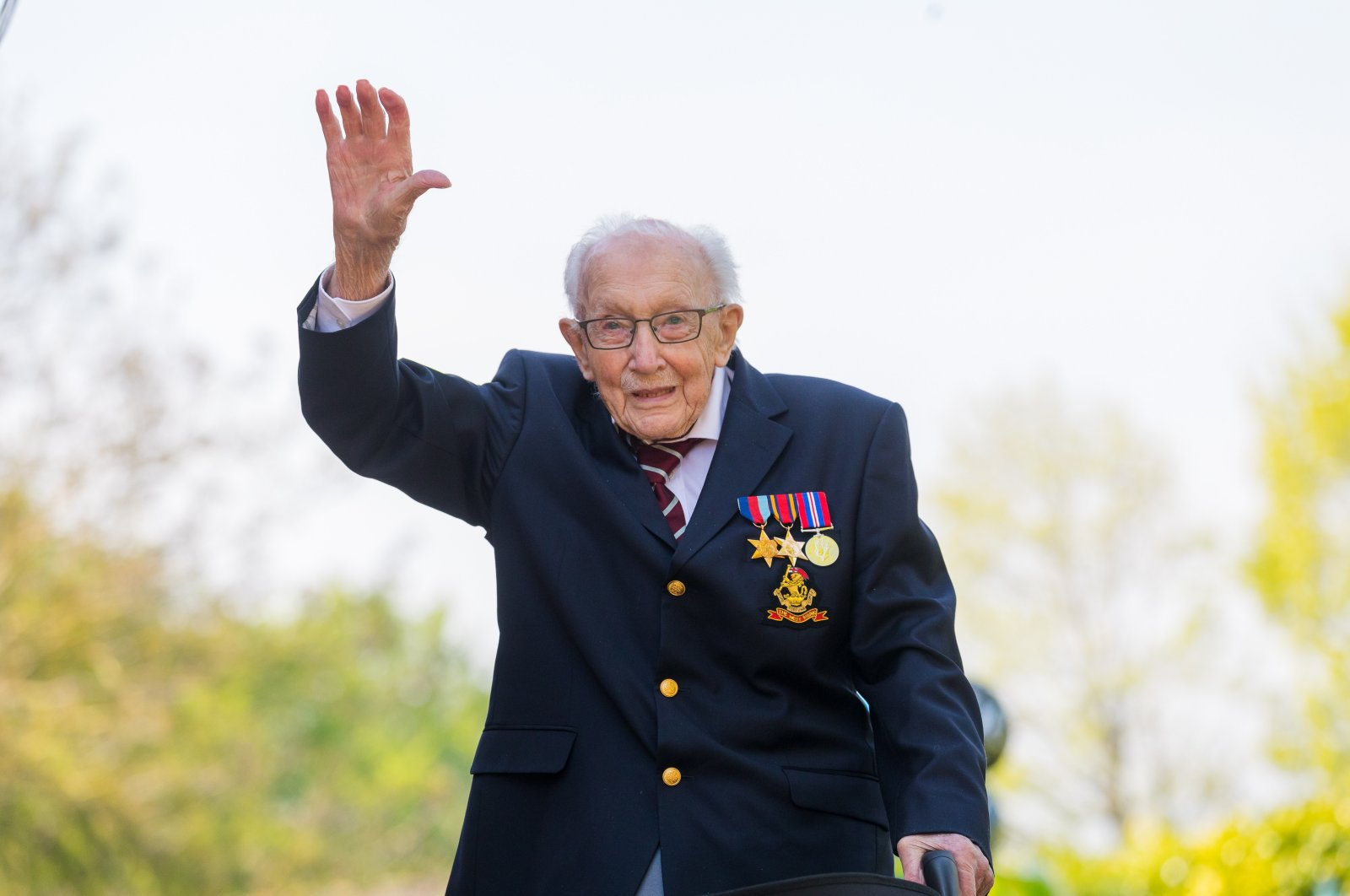 99-year-old British veteran Captain Tom Moore reacts after completing the 100th length of his back garden in Marston Moretaine, Bedfordshire, Britainton Moretaine, Bedfordshire, Britain, April 16, 2020. (EPA Photo)