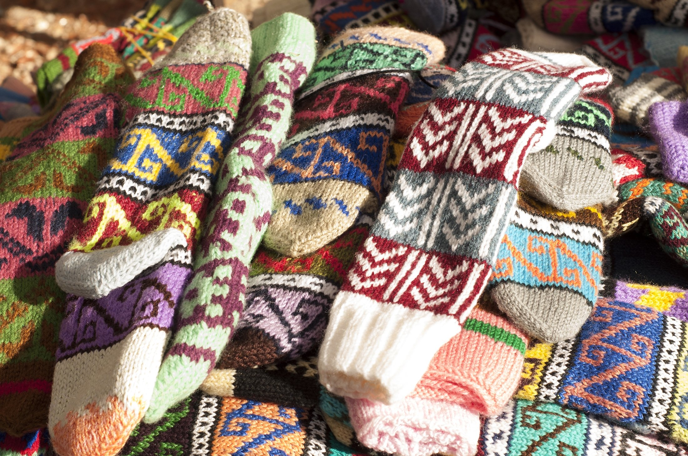 Handmade colorful knitted socks are seen on a market stall in Fethiye. (Shutterstock Photo)