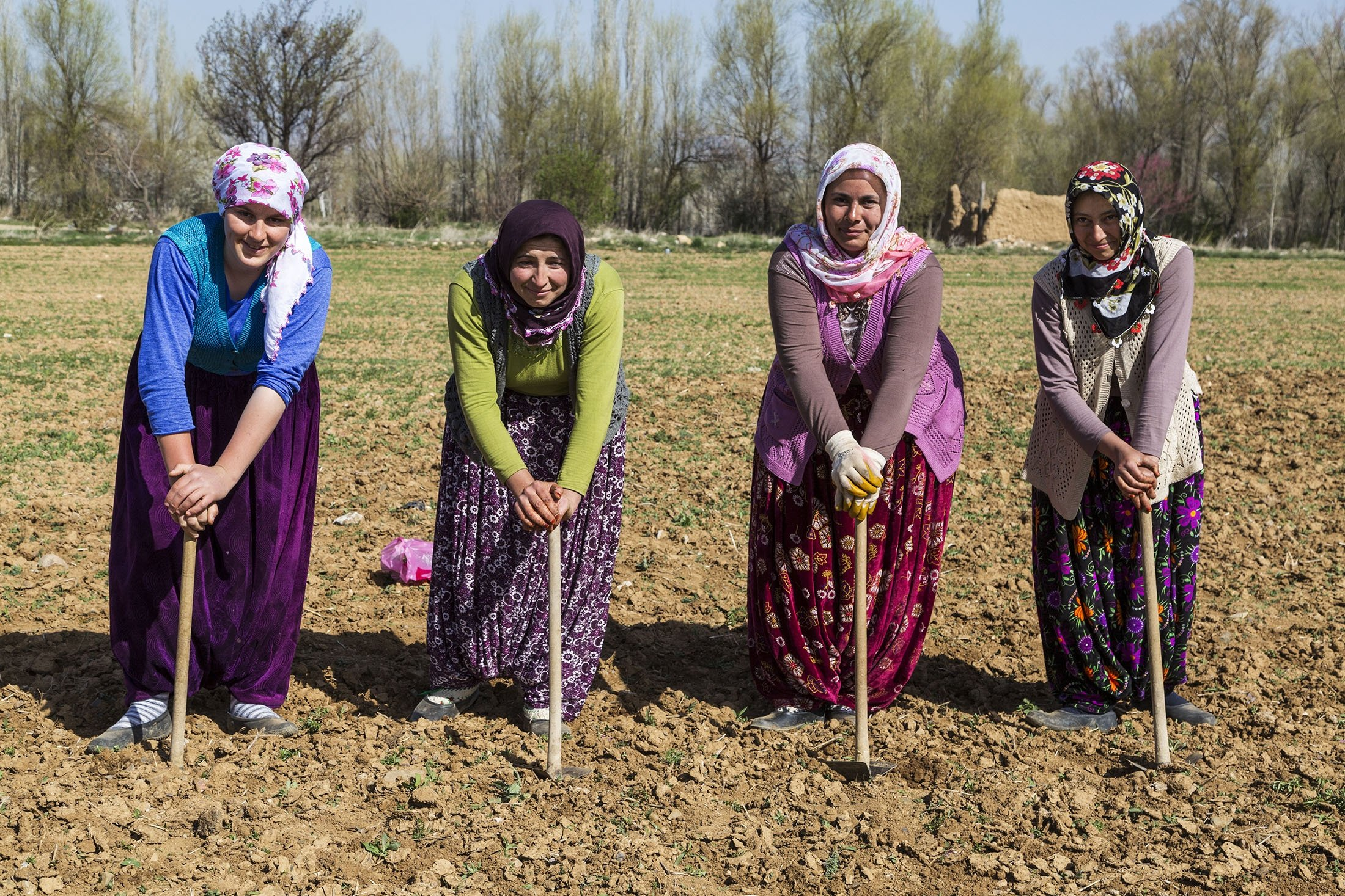 Women working in the fields are seen wearing şalvars in colorful fabrics and patterns in Konya, central Turkey, April 5, 2016. (Shutterstock Photo)