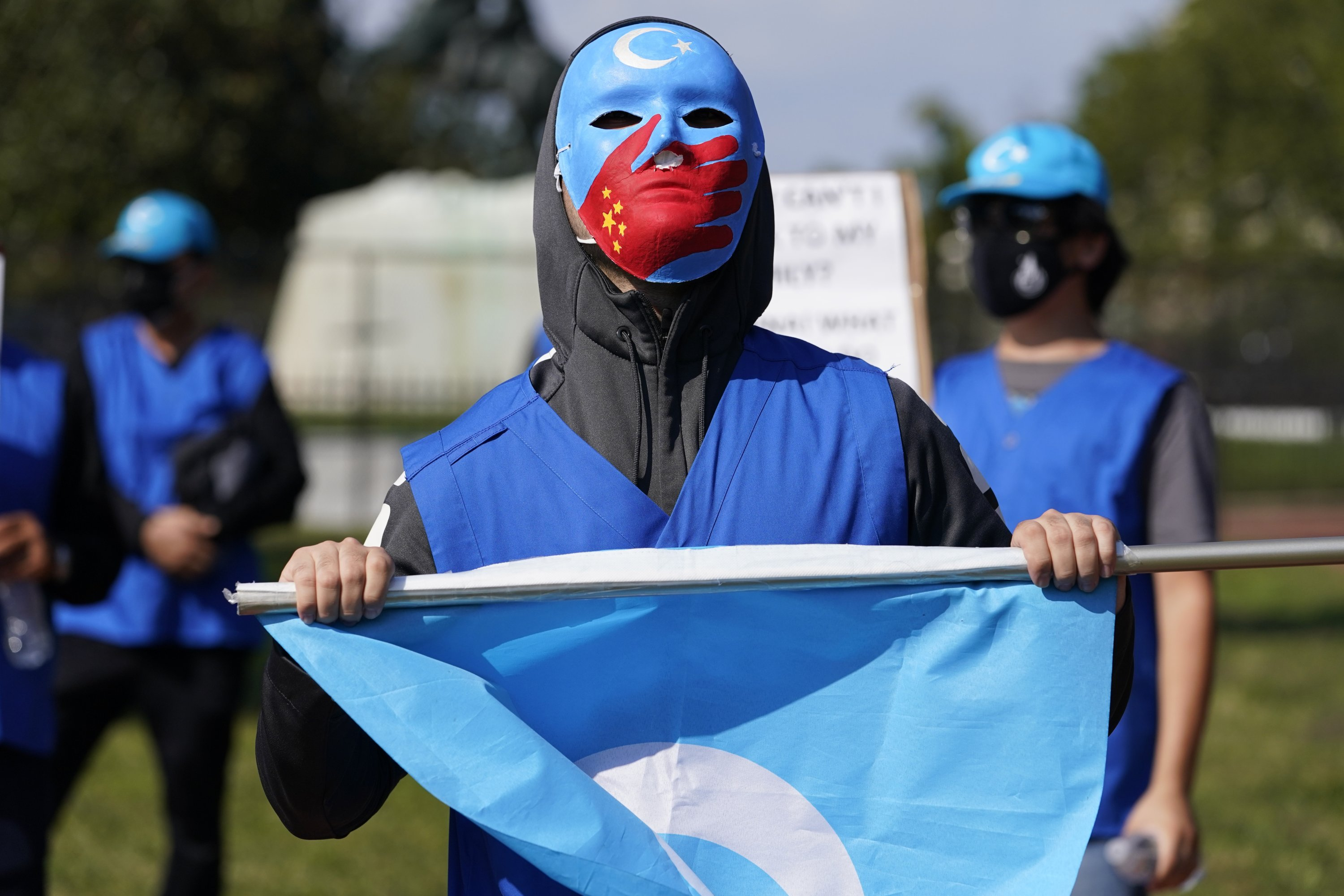 A man wears a mask to support China's Uighur minority, in front of the White House, Washington, D.C., U.S., Oct. 1, 2020. (AP Photo)