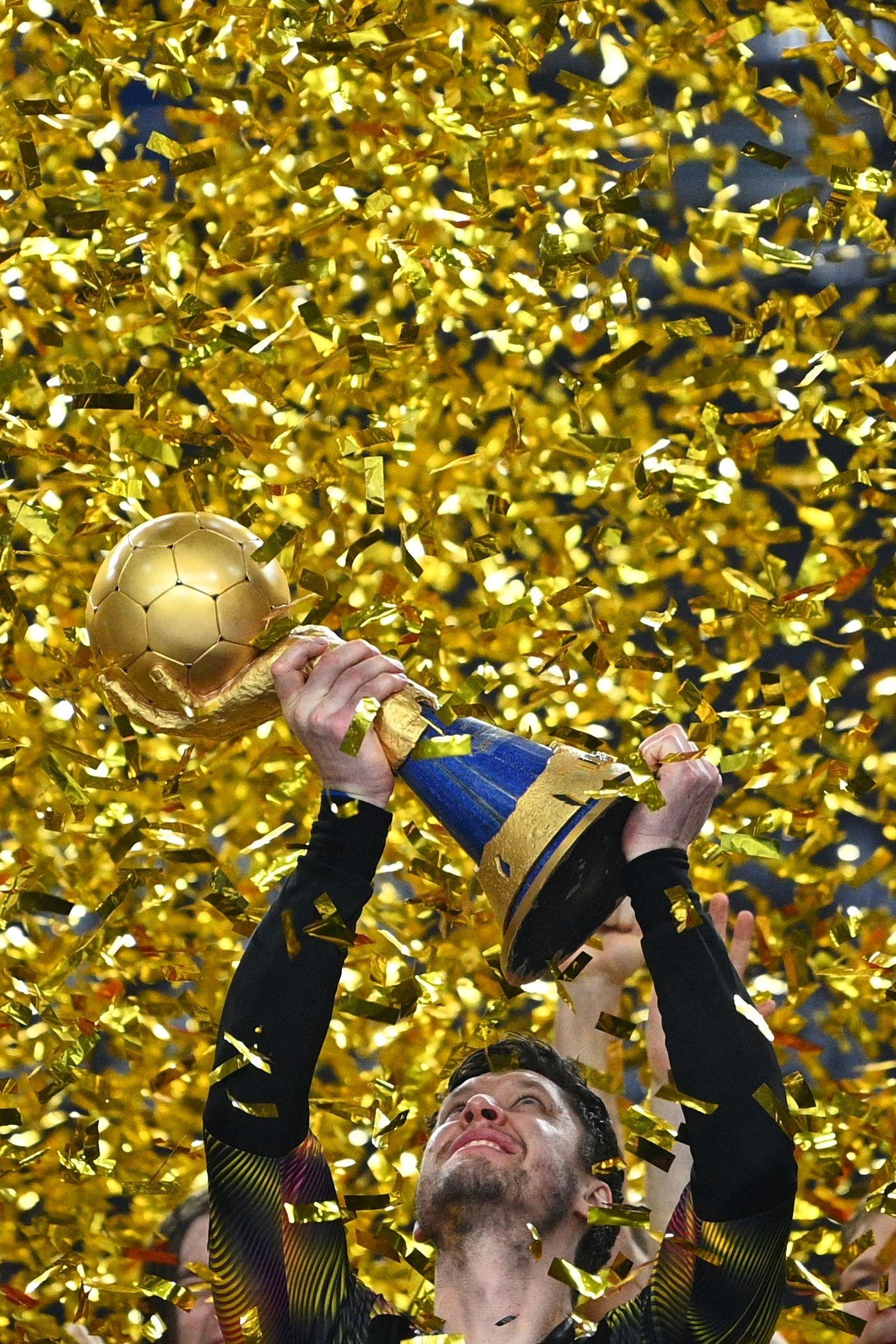 Denmark's goalkeeper Niklas Landin Jacobsen lifts the trophy after the 2021 World Men's Handball Championship final against Sweden at the Cairo Stadium Sports Hall, Cairo, Egypt, Jan. 31, 2021. (AFP Photo)