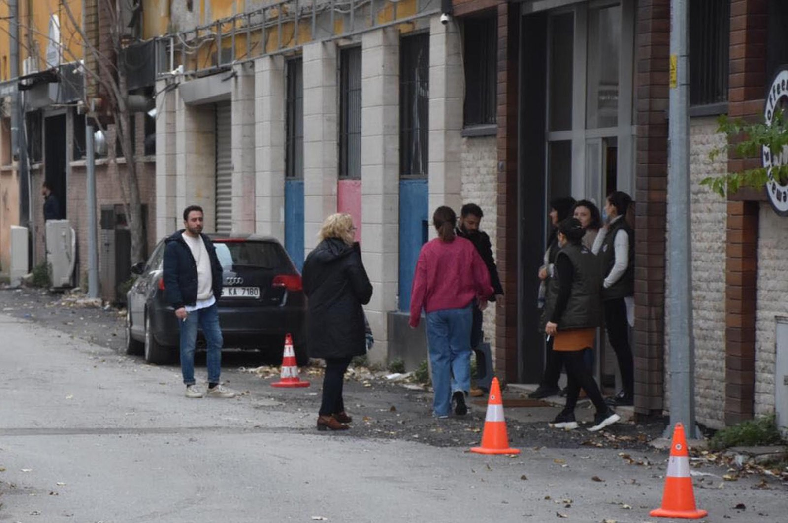 Locals stand outside their homes and offices in Turkey's Izmir after the earthquake, Feb. 1, 2021. (DHA Photo)