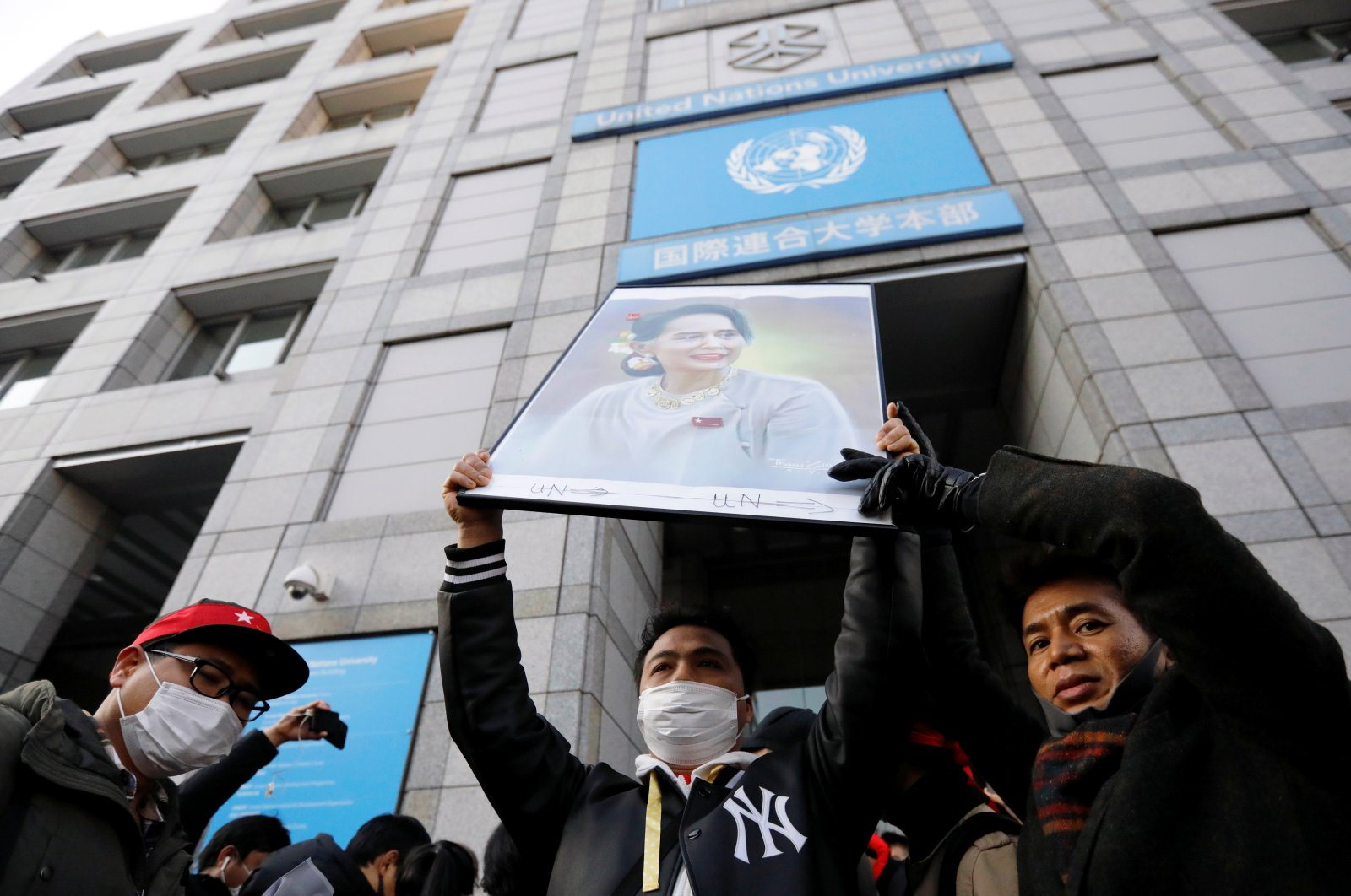 Protesters from Myanmar residing in Japan hold a portrait of leader Aung San Suu Kyi at a rally against Myanmar's military after it seized power from a democratically elected civilian government and arrested Suu Kyi, at United Nations University in Tokyo, Japan, Feb. 1, 2021. (Reuters Photo)