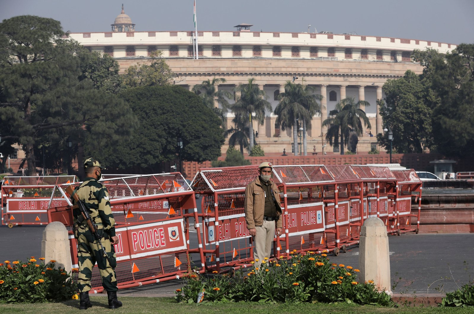 Security personnel stand guard next to barricades outside the Parliament where the annual budget is being presented in New Delhi, India, Feb. 1, 2021. (Reuters Photo)