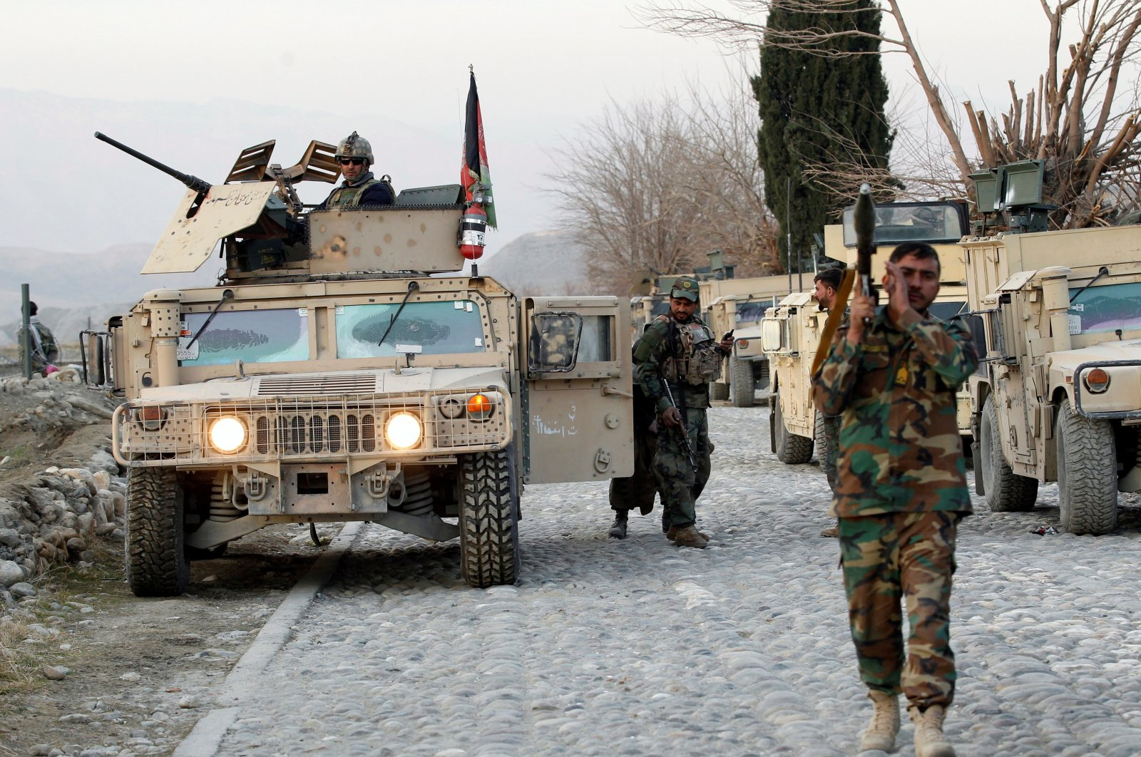 Afghan National Army soldiers inspect the site of a car bomb attack on a military base in the Shirzad district of Nangarhar province, Afghanistan, Jan. 30, 2021. (Reuters Photo)