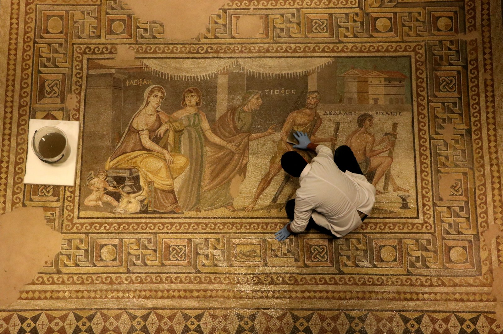 An expert cleans a mosaic at the Zeugma Mosaic Museum, Gaziantep, southeastern Turkey, Jan. 29, 2021. (AA Photo)
