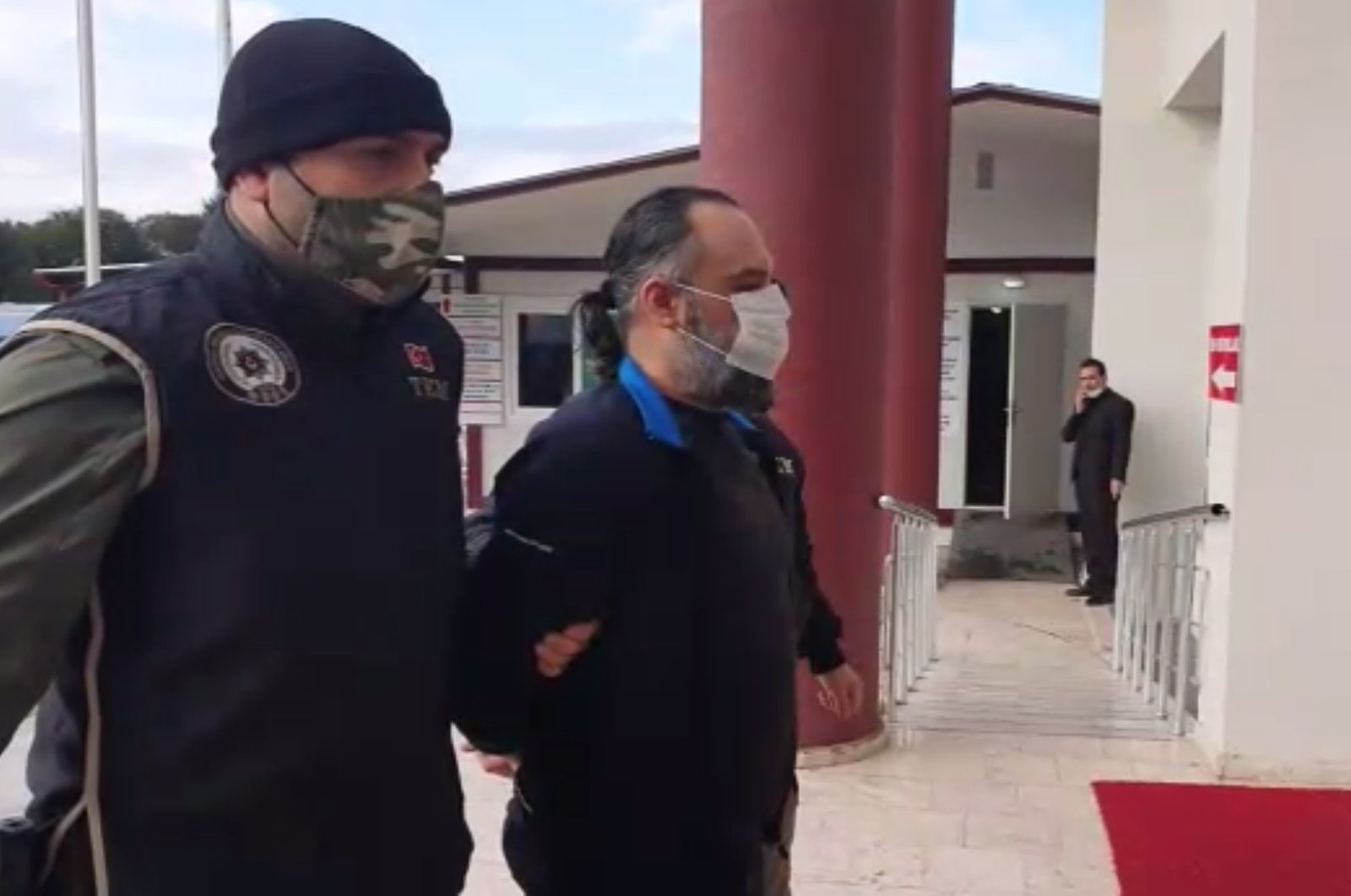 Detained Daesh terrorist brought to police station in Turkey's Yalova province on Feb. 1, 2021 (AA Photo)