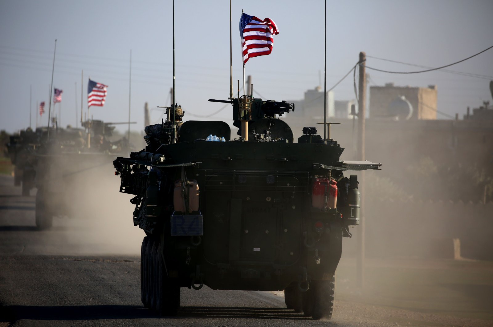 A convoy of U.S. forces armored vehicles drives near the village of Yalanli, on the western outskirts of the northern Syrian city of Manbij, on March 5, 2017. (AFP File Photo)