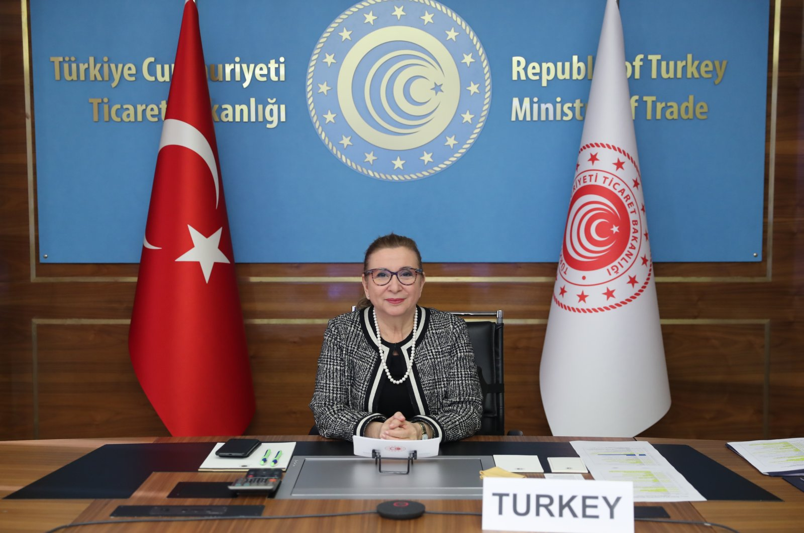 Trade Minister Ruhsar Pekcan sits at a desk during the virtual World Trade Organization (WTO) Unofficial Ministeries Meeting hosted by the Swiss government, in the capital Ankara, Turkey, Jan. 30, 2021. (AA Photo)