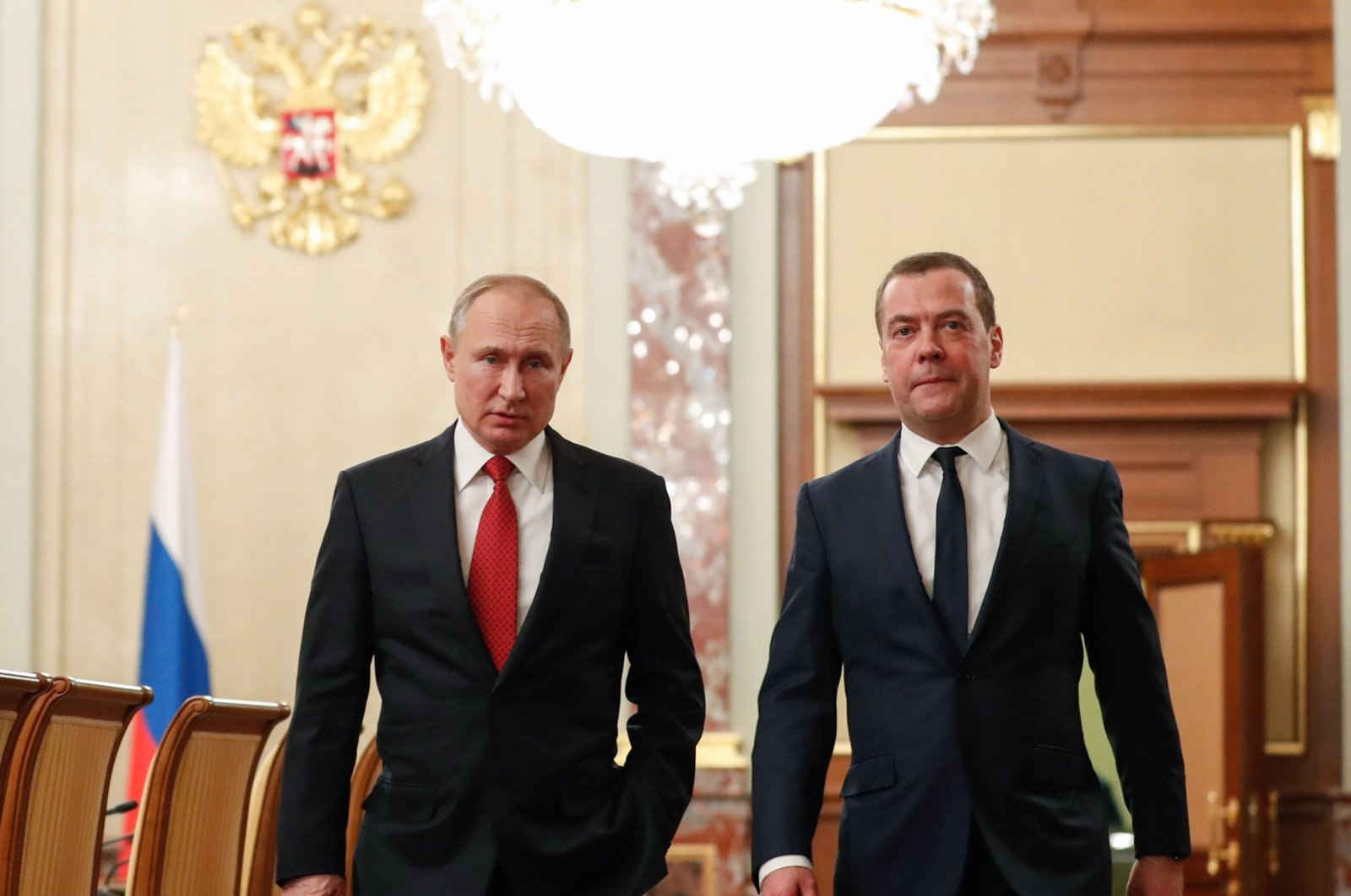 Russian President Vladimir Putin and then-Prime Minister Dmitry Medvedev walk before a meeting with members of the government in Moscow, Russia, Jan. 15, 2020. (AFP Photo)