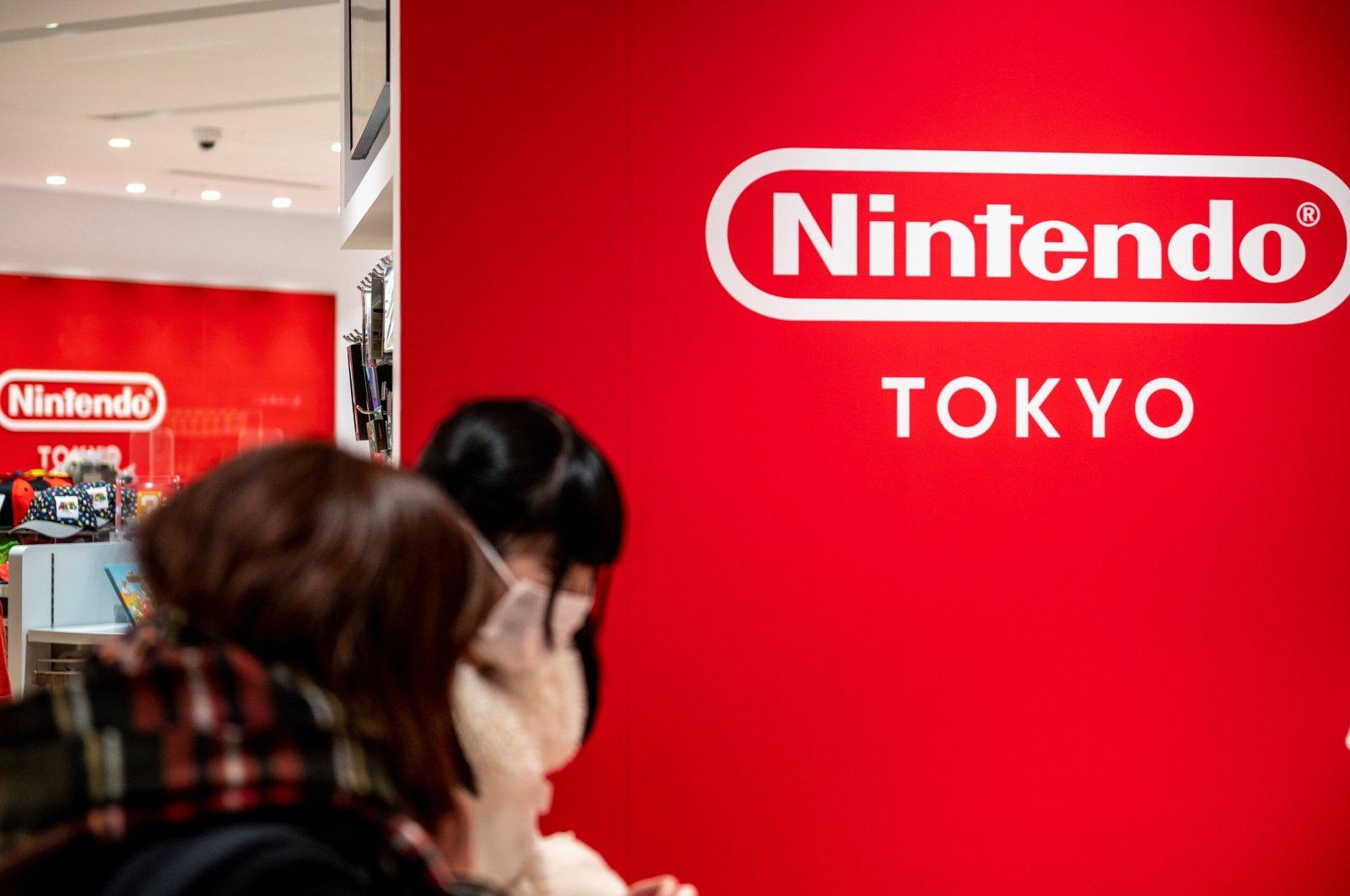 Customers shop at a Nintendo store in Tokyo, Japan, Feb. 1, 2021. (AFP Photo)