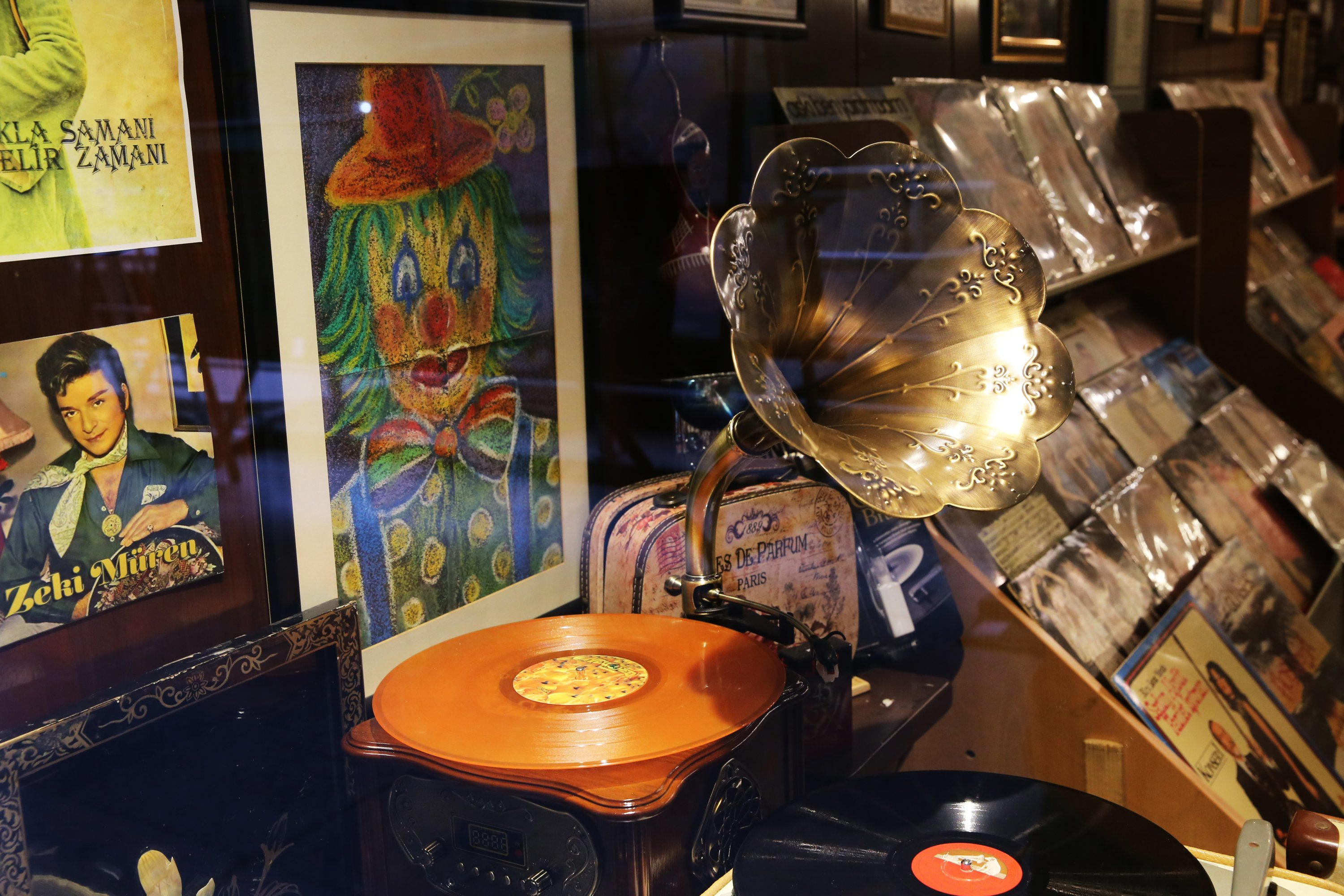 A phonograph, posters and records in a shop at the Unkapanı record sellers' bazaar in Istanbul, Turkey, Feb. 2, 2021. (AA PHOTO)