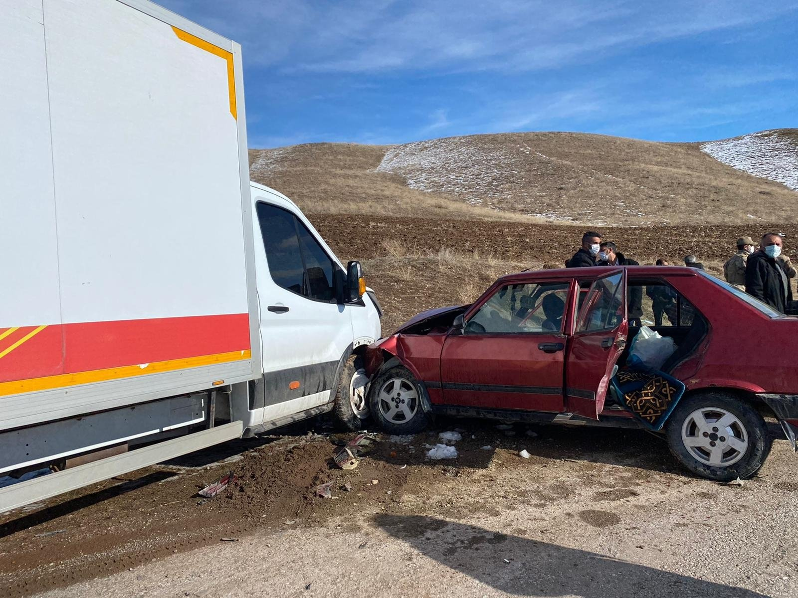 The two vehicles collided, injuring six people, in Erzincan, northeastern Turkey, Feb. 2, 2021. (AA PHOTO)