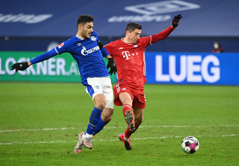Schalke 04's Turkish defender Ozan Kabak (L) in action against Bayern Munich's Robert Lewandowski in a Bundesliga match, Veltins-Arena, Gelsenkirchen, Germany, Jan. 24, 2021. (REUTERS Photo)
