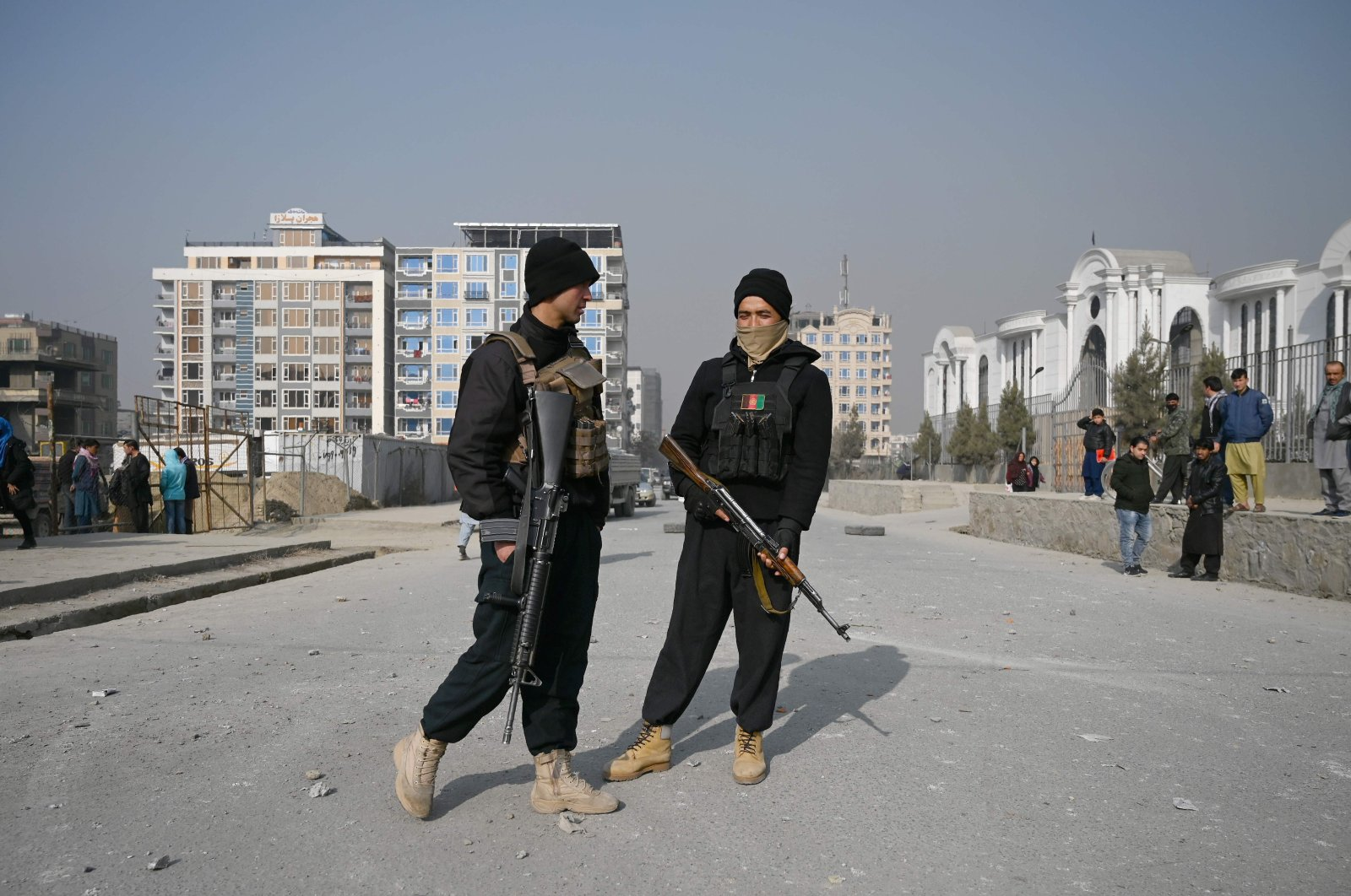 Policemen stand guard at the site of a bomb blast in Kabul on Feb. 2, 2021. (AFP Photo)