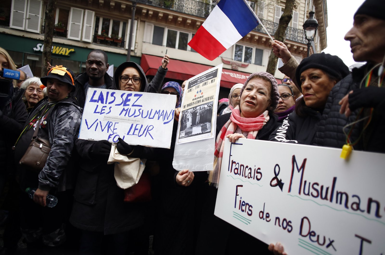 Protestors hold placards during a demonstration against Islamophobia, in Paris, France, Nov. 10, 2019. (AP File Photo)