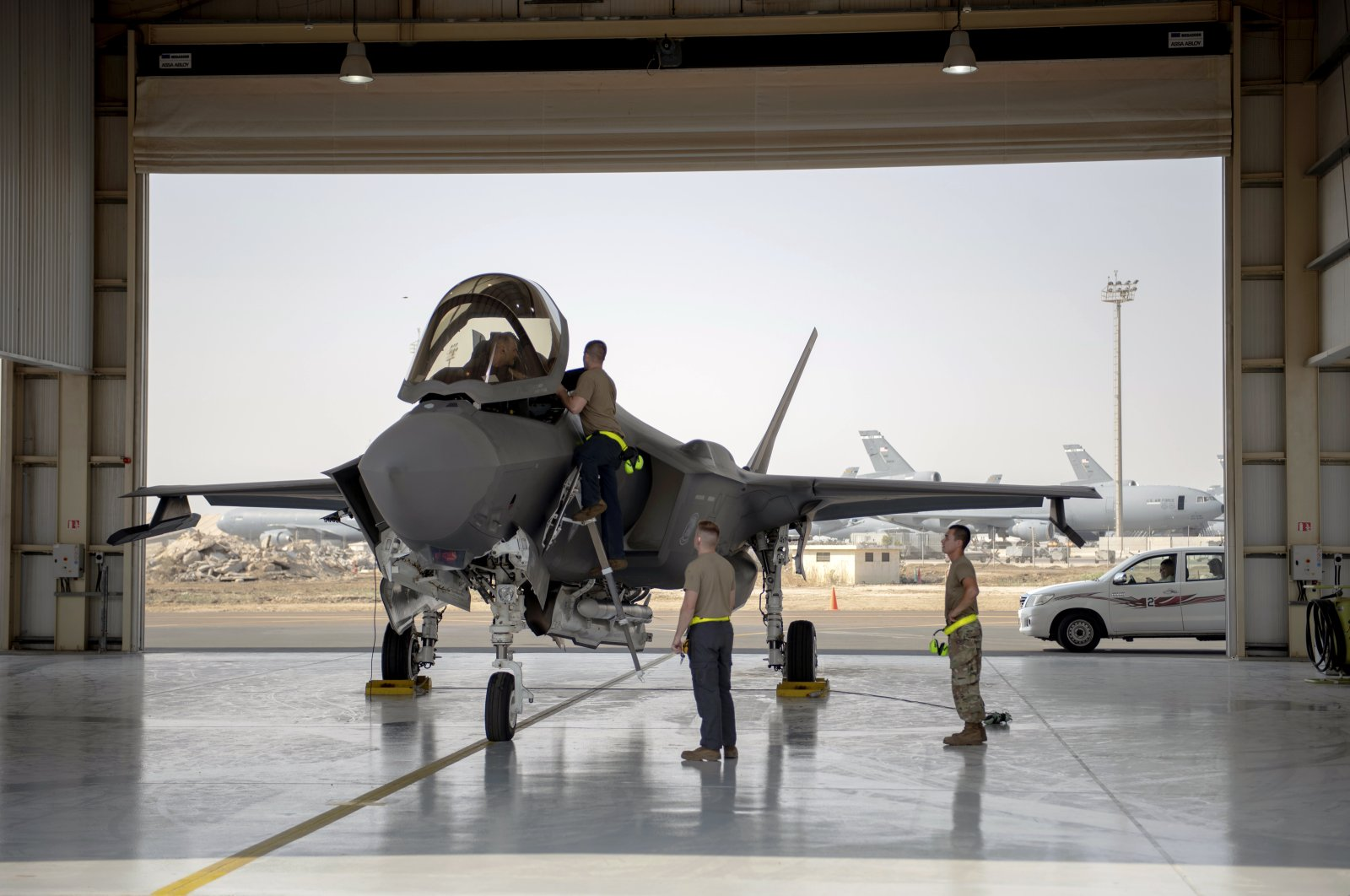 An F-35 fighter jet pilot and crew prepare for a mission at Al-Dhafra Air Base, in the United Arab Emirates, Aug. 5, 2019. (U.S. Air Force via AP)