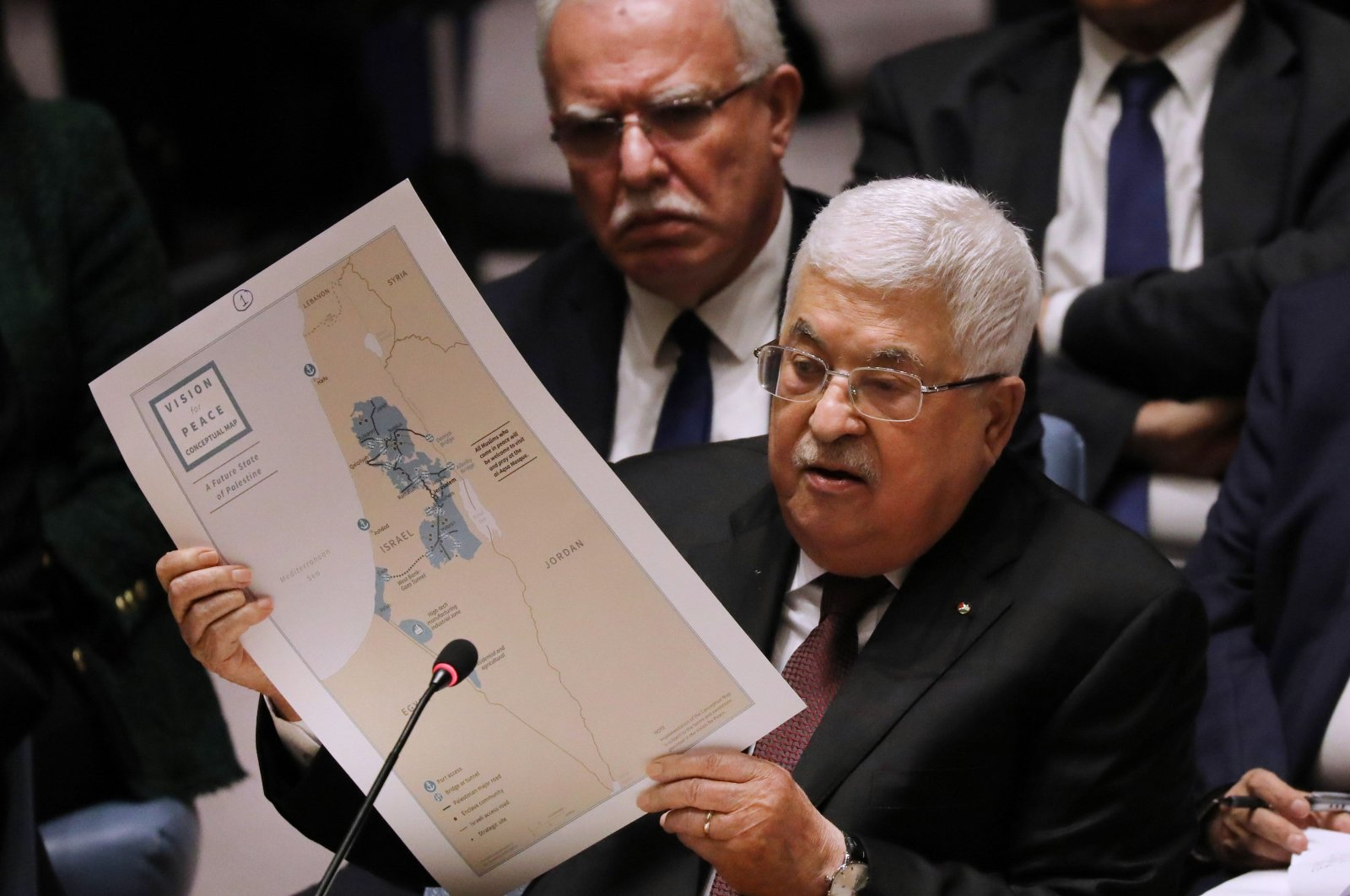Palestinian President Mahmoud Abbas holds up a Vision for Peace map while speaking at the United Nations Security Council in New York City, U.S., on Feb. 11, 2020. (Spencer Platt/Getty Images/AFP)