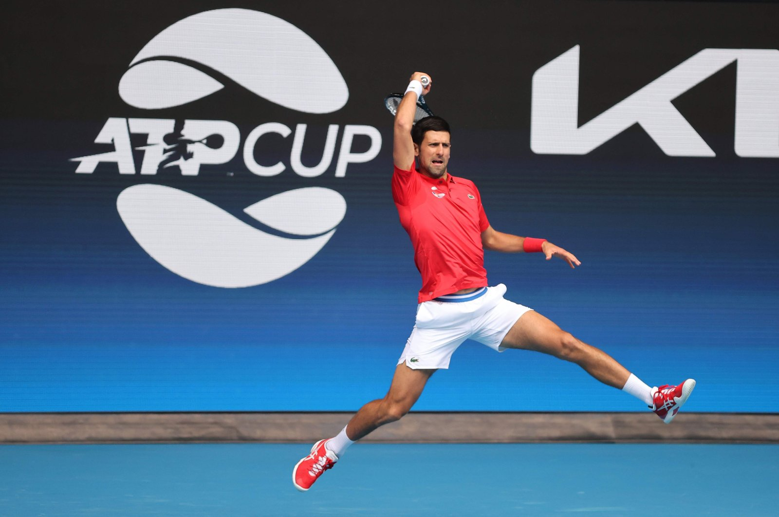 Serbia's Novak Djokovic hits a return against Canada's Denis Shapovalov during their group A men's singles match at the 2021 ATP Cup, Melbourne, Australia, Feb. 2, 2021. (AFP Photo)