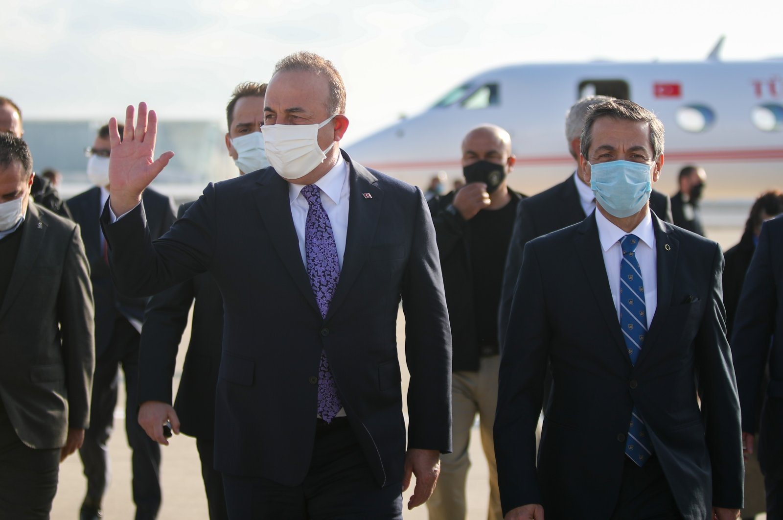 Foreign Minister Mevlüt Çavuşoğlu is welcomed by his Turkish Cypriot counterpart Tahsin Ertuğruloğlu after landing in Ercan Airport in Lefkoşa (Nicosia), Feb.1, 2021. (AA)